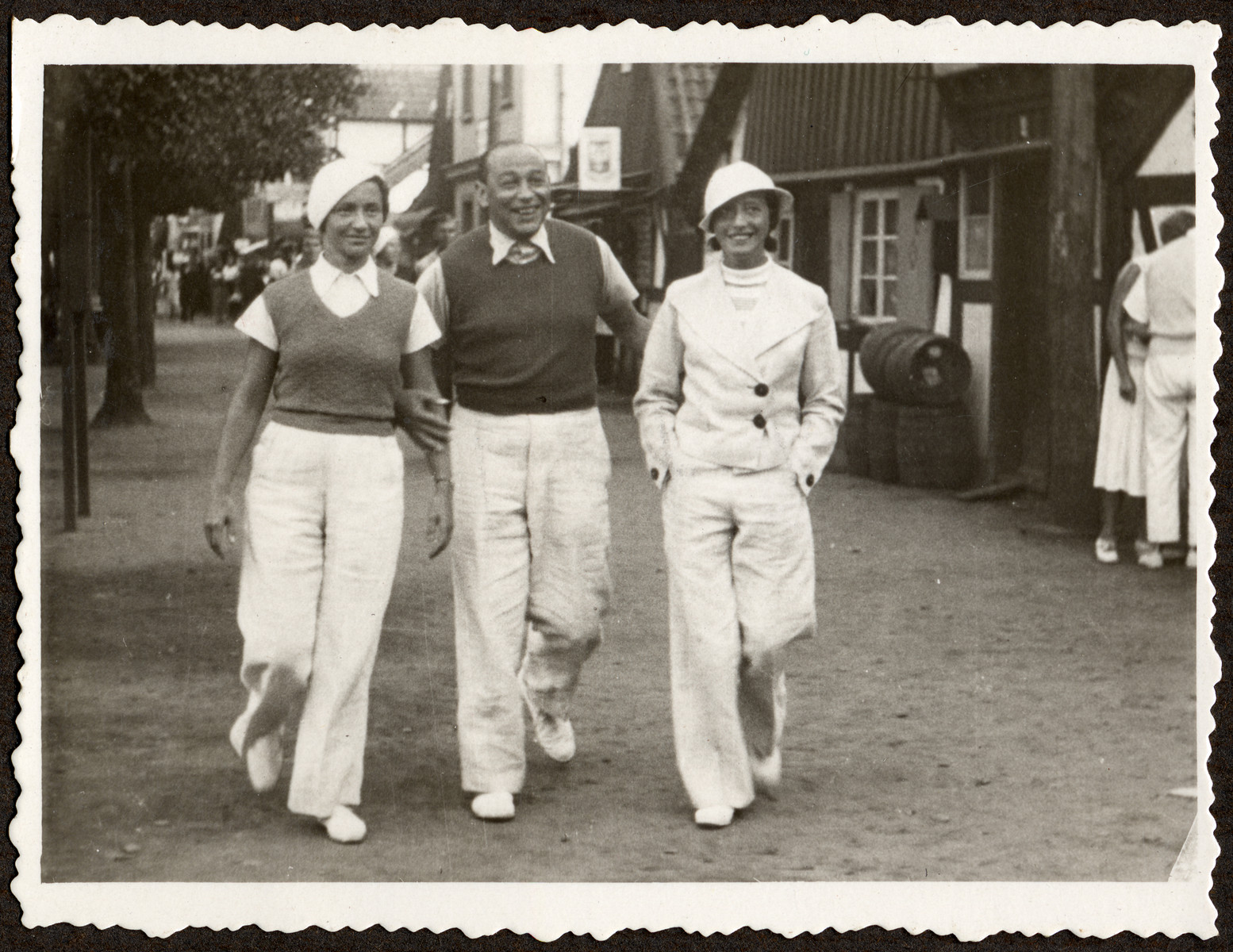 Jerzy and Nadzieja Klein walk down the street of a small town with a friend while on vacation in prewar Poland.