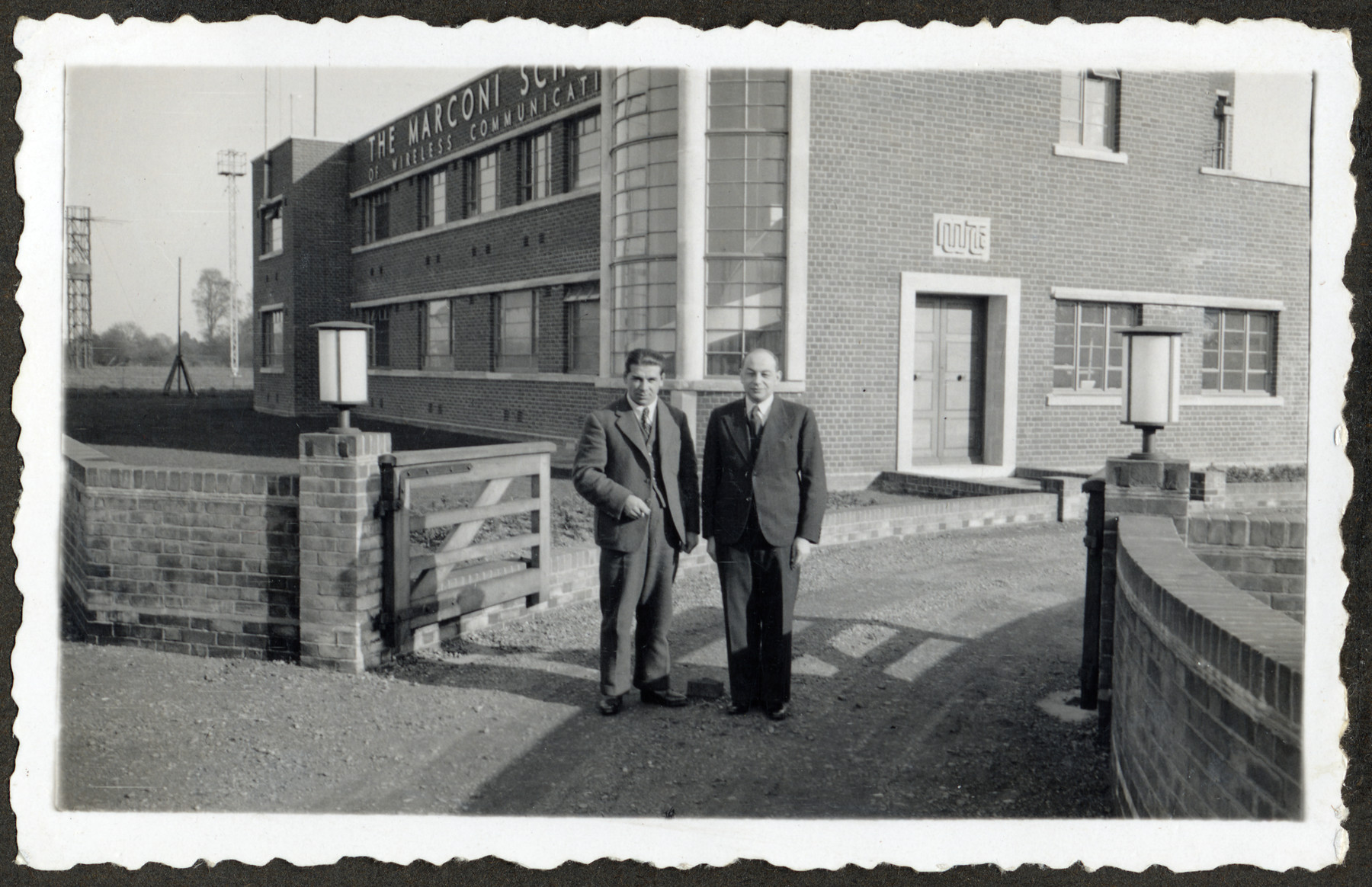 Electrical engineer and Jewish immigrant Jerzy Kent (formerly Klein) stands outside the Marconi School for Wireless Communications.