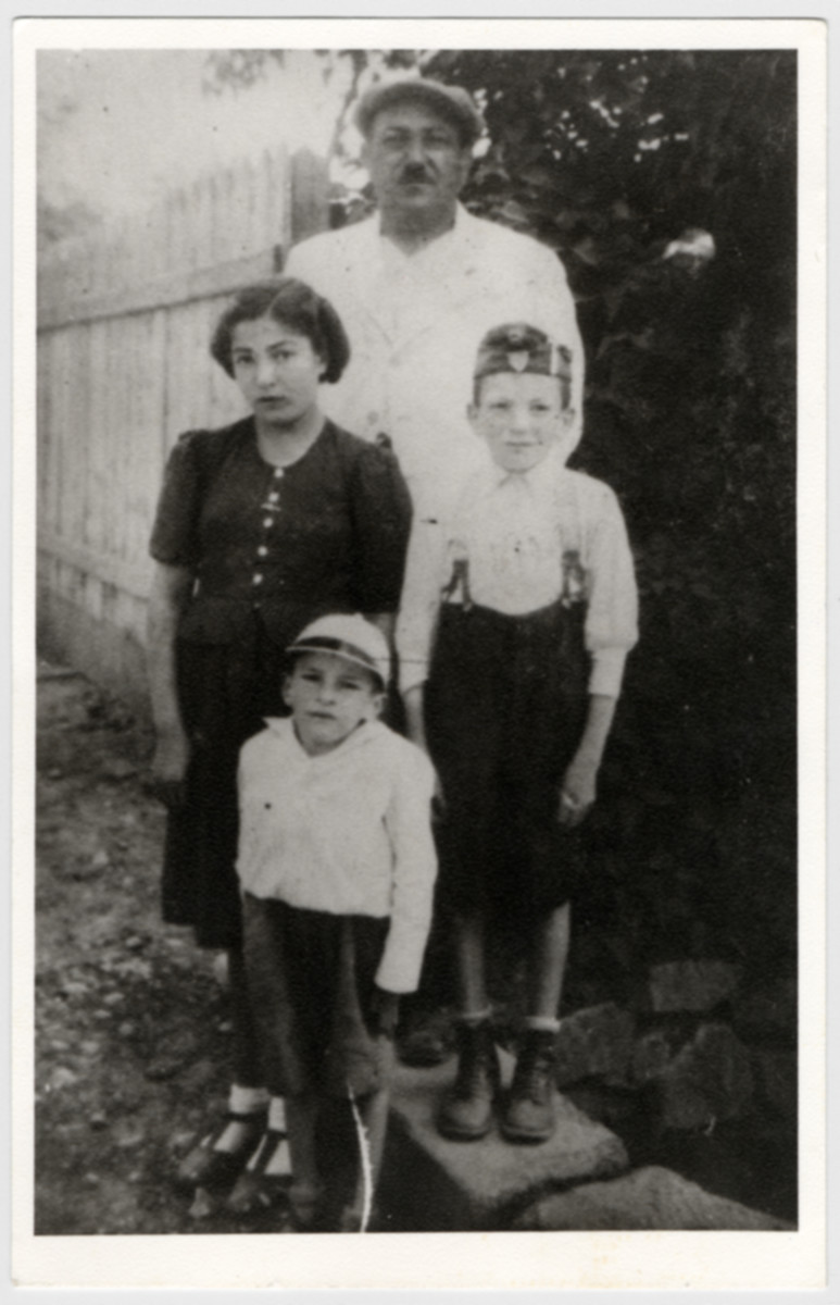 Portrait of Yitzchak Ganzl, his wife and children.  All were later deported to Auschwitz.