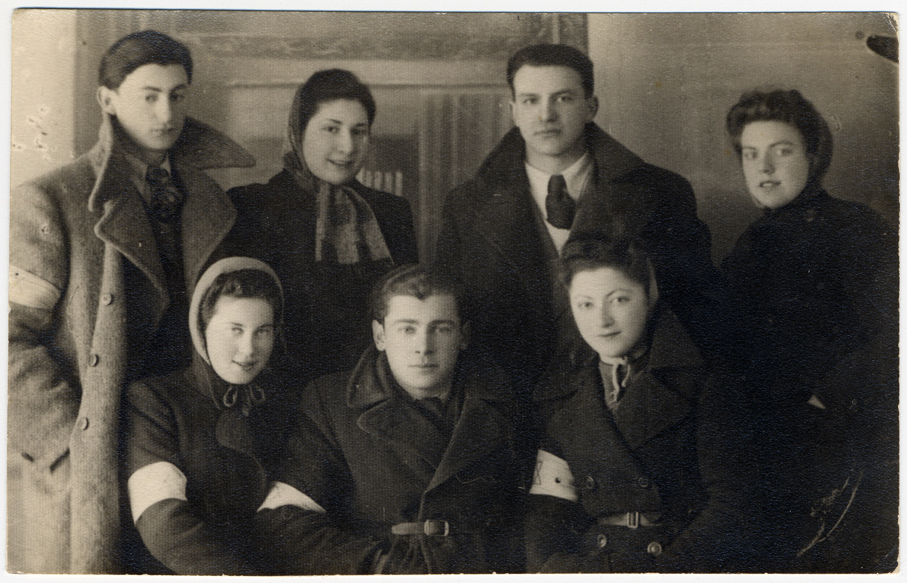 Group portrait of Jewish youth in the Bolechow ghetto.   Pictured standing from the left are: Simon Weiss, Lila Berger, Bumek Josefsberg and the donor's sister, Musia Adler.  Sitting, from the left, are: Bela Altman, unknown and Dyzia Lew.