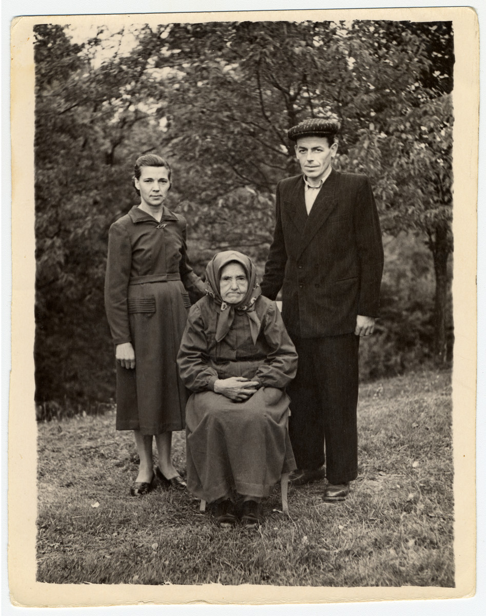 Group portrait of the Raduchowski family who hid Salek Adler for 13 months.   Sitting is Maria Raduchowska, who prepared the hiding place, her son Michal and his wife Julia.