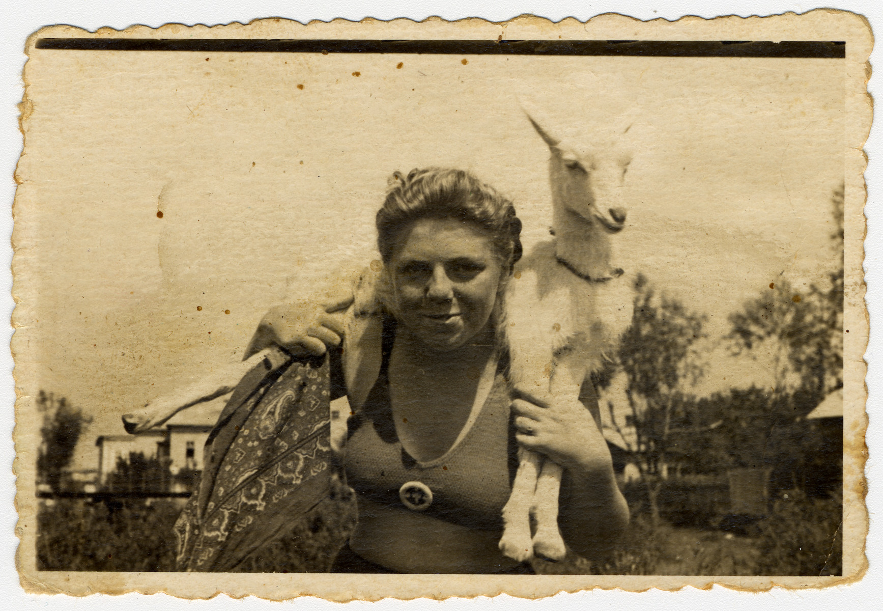Close-up portrait of Musia Adler, the donor's sister holding a kid goat.