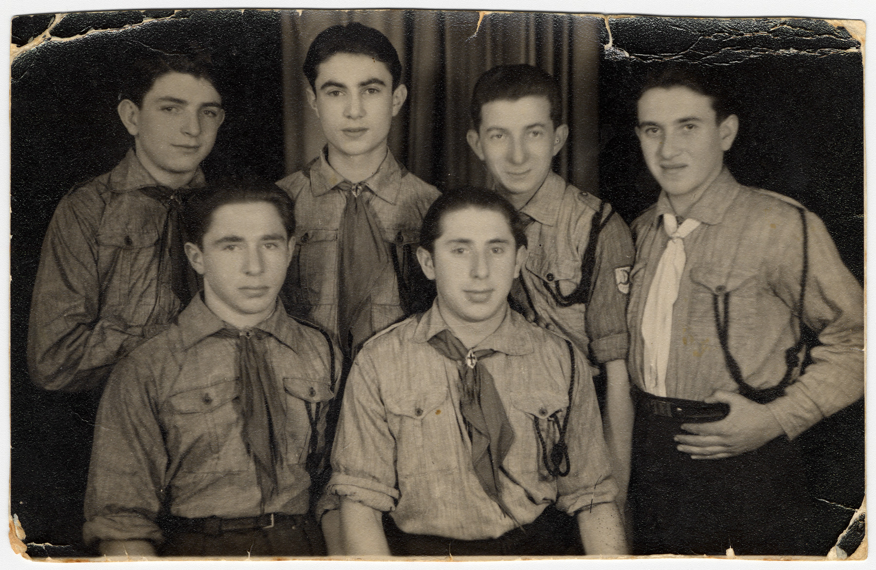 Group portrait of members of the Gordonia Zionist Youth movement in Bielsko Biala after the war.   Pictured standing, from the left are: the donor, Mishka Brzostek, David Szifman and Zwi Ickowicz.  Sitting are: Natan Reich and Eliezer Slepski (Ben Meir).