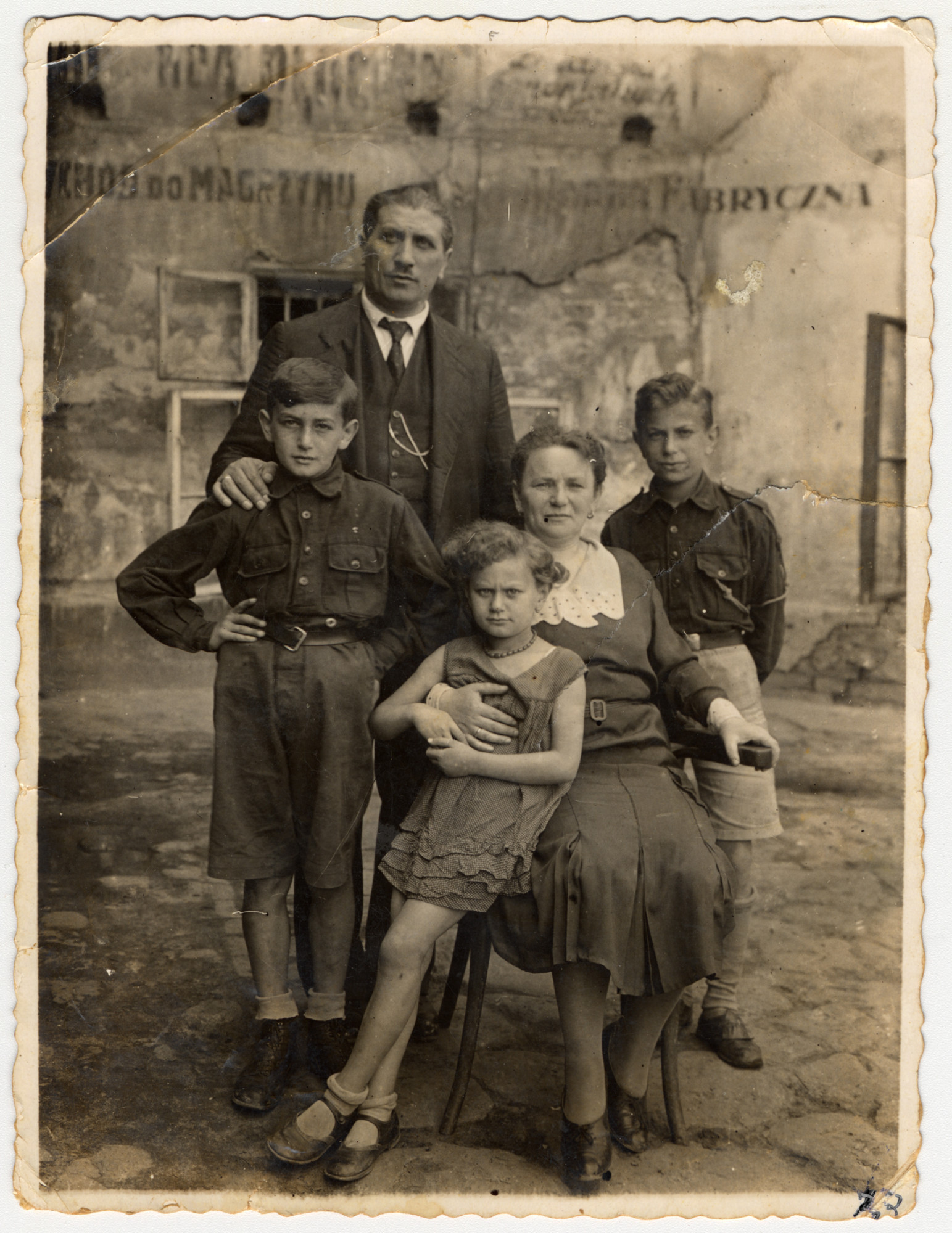 Prewar portrait of a Jewish family in Lvov.  Pictured are Samuel and Adela Shiber with their three children: Salomon, Matylda and Emanuel (on the right).  The building in the back may be Samuel Schiber's textile workshop.