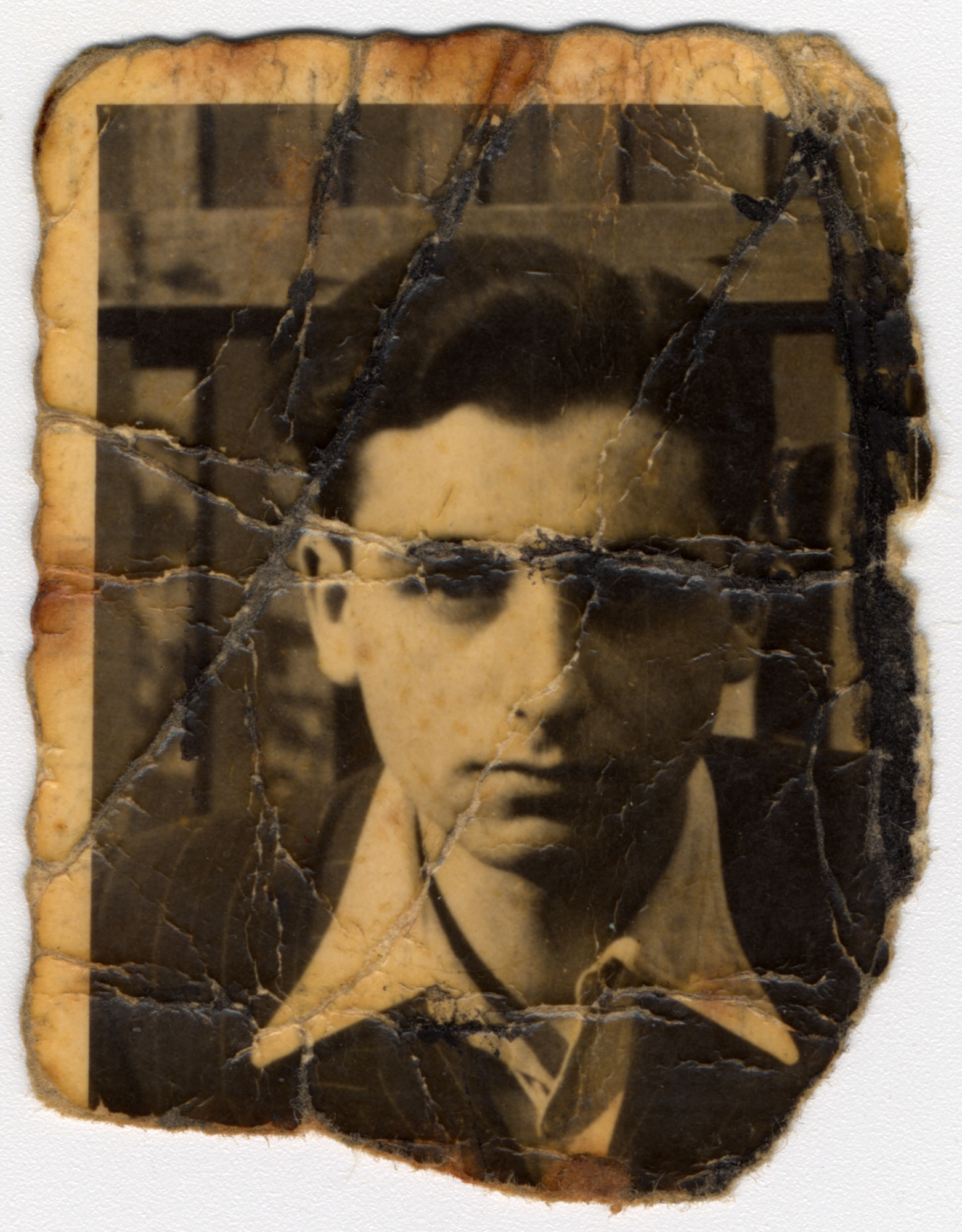 """Close-up portrait of a young man in the Bedzin ghetto.   Pictured is Alex Lieberman, donor's brother-in-law.  The portrait was found in """"Kanada"""" section in Birkenau in 1944 and brought to his mother, Rosa Lieberman.  Rosa hid this photograph in her mouth through every selection and search during her imprisonment in Birkenau, and she later carried it with her on death marches to Ravensbrueck and Neustadt-Gleve."""