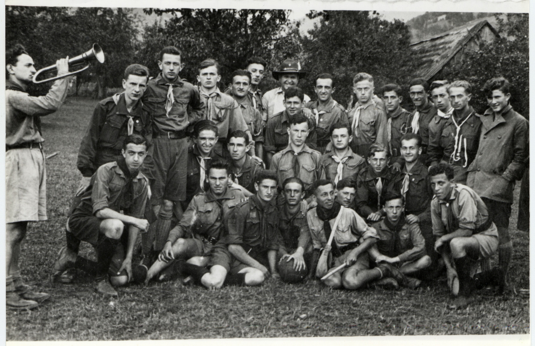 Group portrait of instructors of the Hanoar Hatzioni Zionist Youth movement at a summer camp in Lvov.   Standing on the far left is Lerner.  Sitting in the front row are Izio Hibner (third from the left) and Natek Tunc (first from the right).  Also pictured is the donor's cousin Marceli Najder (standing center with a hat).