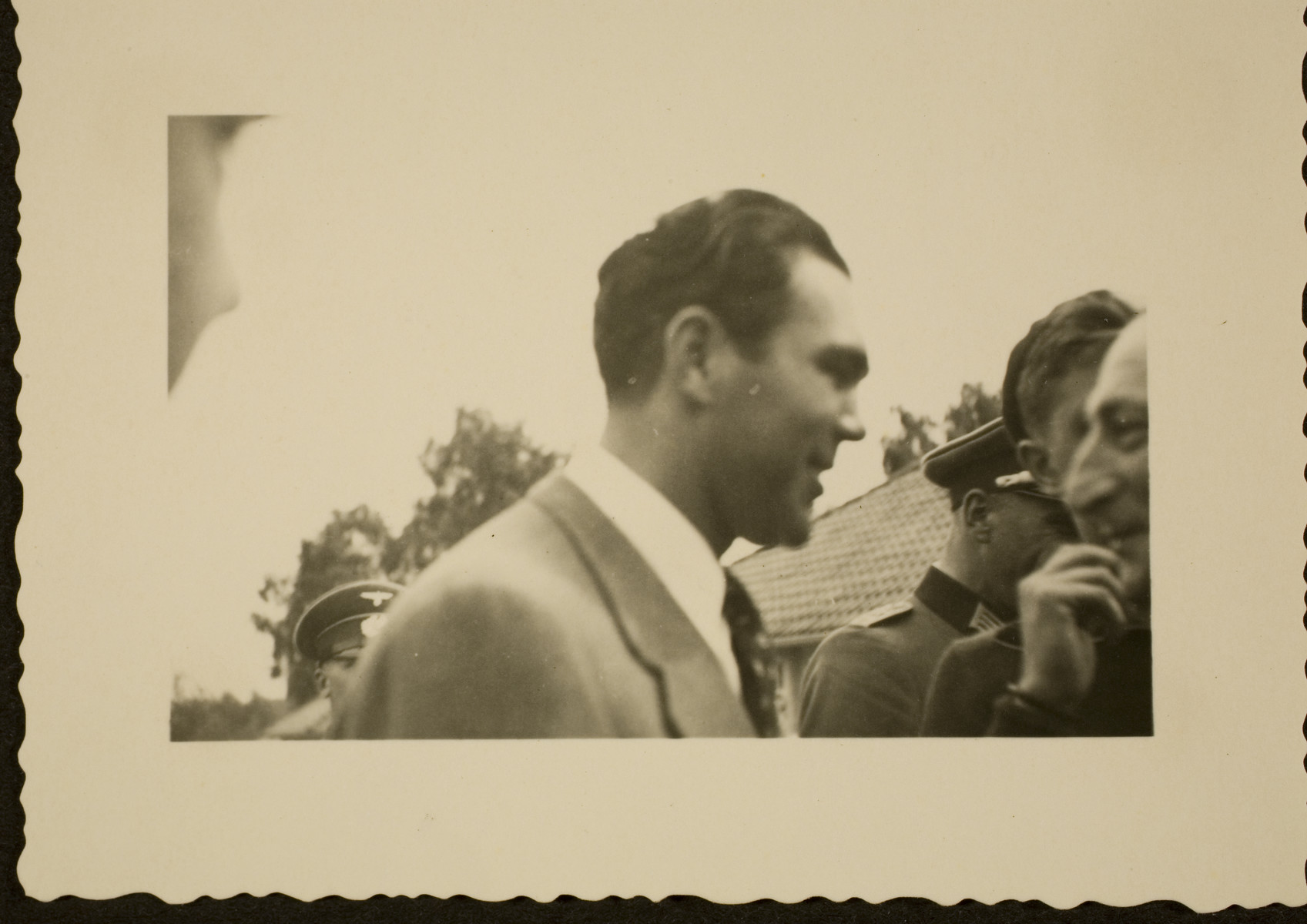 Max Schmeling is surrounded by Nazi officials and other admirers at the Berlin Olympics.