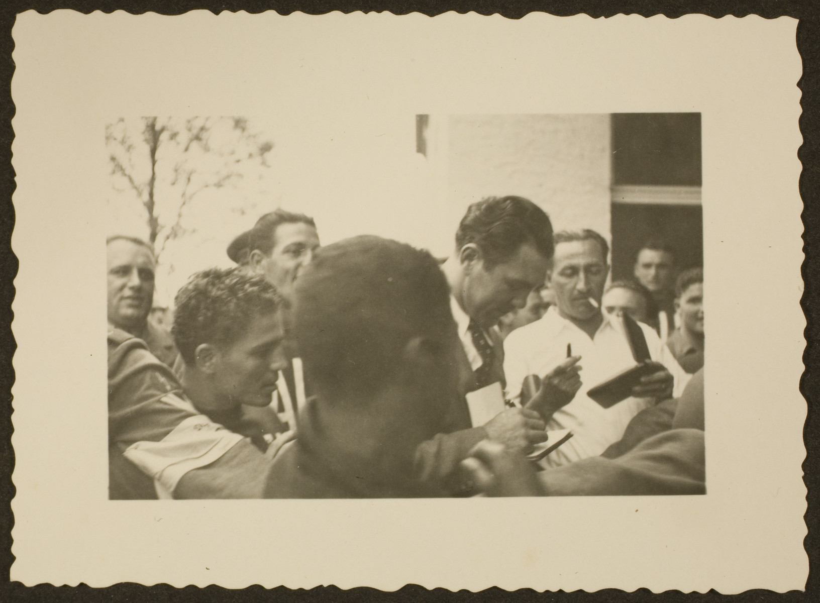 Max Schmeling signs autographs during the Berlin Olympics.