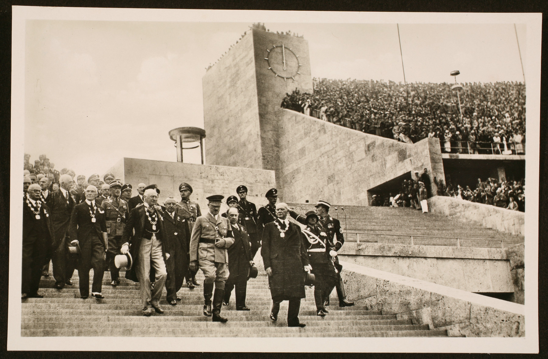 Hitler descends the stairs of the Olympic Stadium with several members of the International Olympic Committee, including Dr. Theo Lewald (R) and Henri de Baillet-Latour, the IOC president (L), to open the 11th Olympic Games.