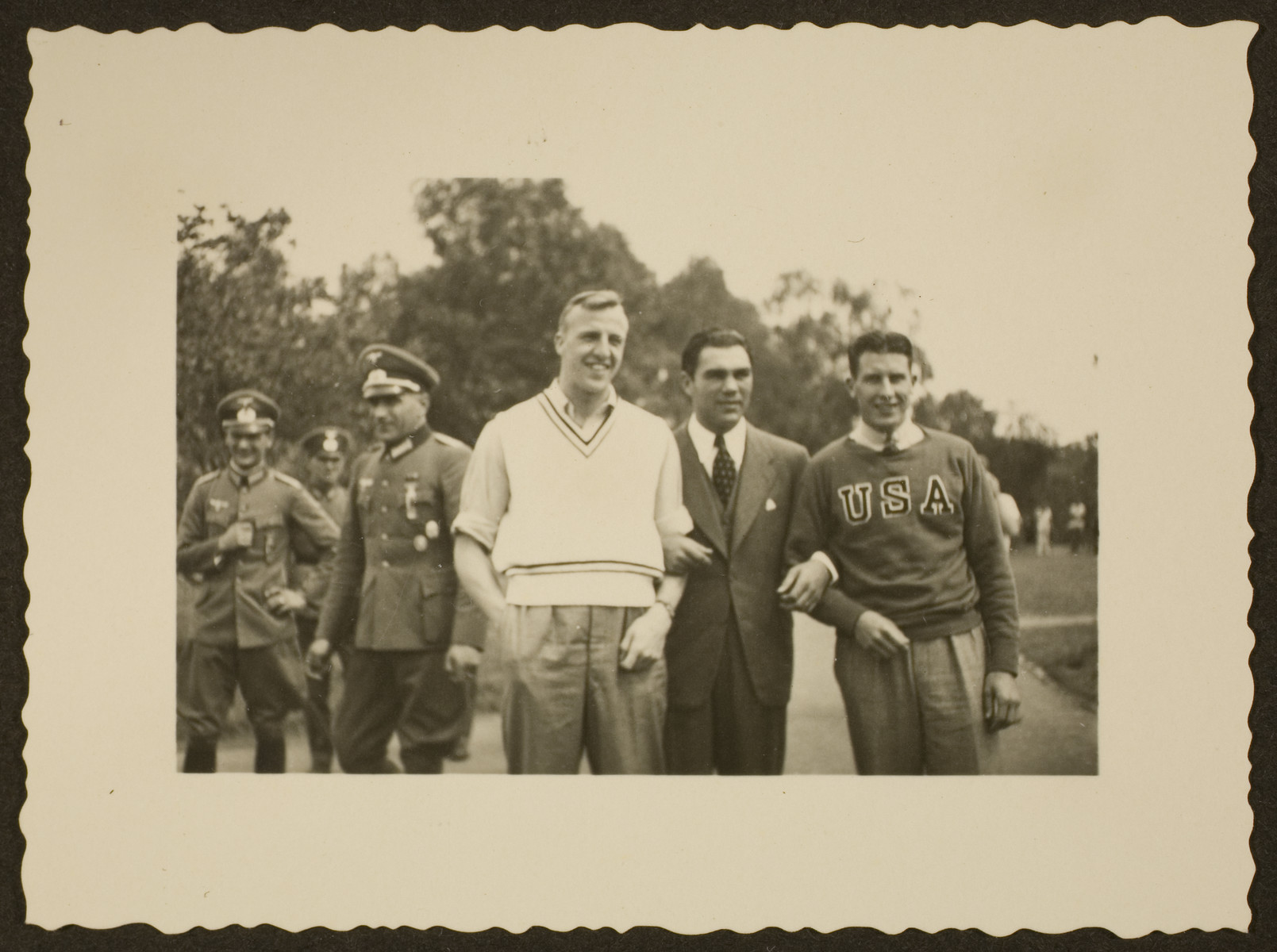 Max Schmeling poses with Glenn Morris, American gold medalist in the decathlon, and another man at the Berlin Olympics.