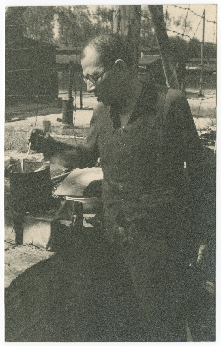 A survivor of either Ohrdruf or Buchenwald concentration camp prepares a light meal after liberation.