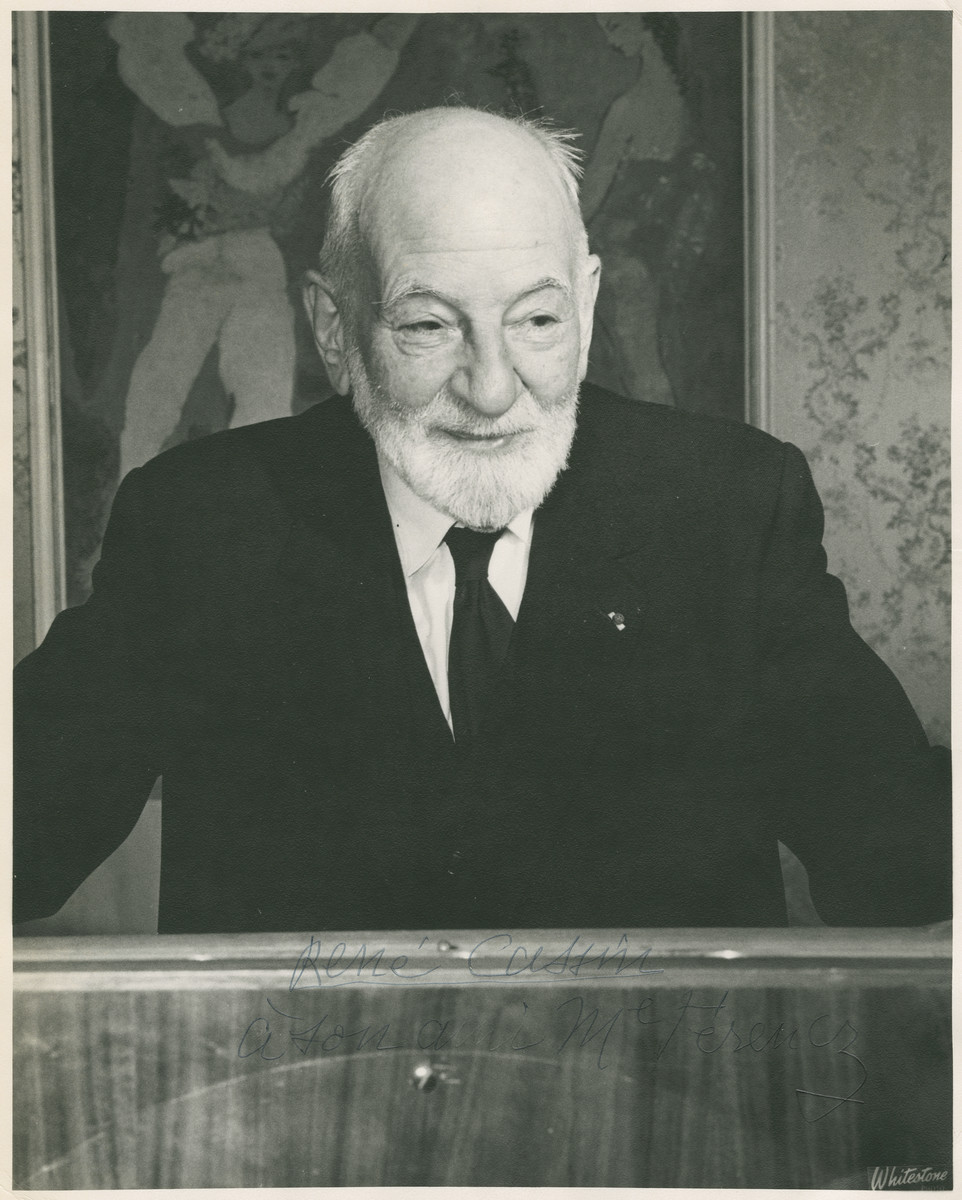 Nobel Peace Prize winner Rene Cassin stands at a podium at the Waldorf Astoria hotel in New York City at a luncheon hosted by Bnai Brith honoring him.     This print, inscribed by Cassin to Benjamin Ferencz the donor, reads, 'Rene Cassin à son ami M. Ferencz' [Rene Cassin to my friend Mr. Ferencz].  Cassin was awarded the Nobel Peace Prize in 1968 for writing the Universal Declaration of Human Rights which was adopted by the United Nations.
