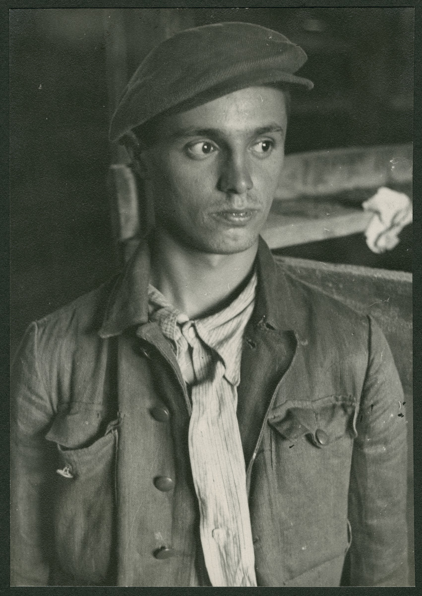 Close-up portrait of a survivor inside a barrack of the Buchenwald concentration camp.