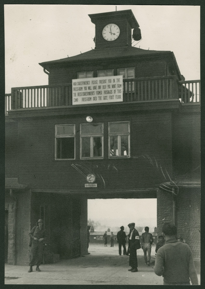 View of the main entrance to the Buchenwald concentration camp.  The sign instructs war correspondents to report to the press room to receive assistance from former prisoners.