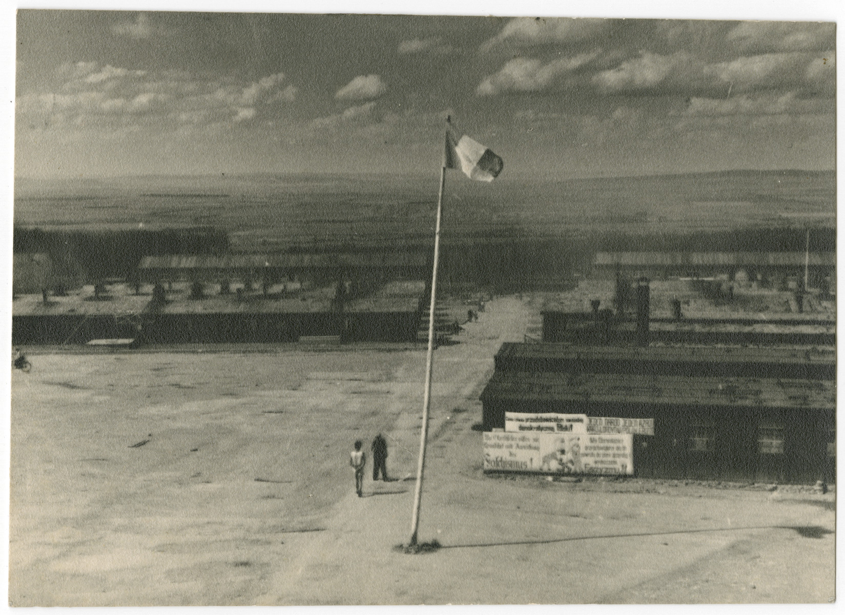 An allied flag [probably French] flies in the central courtyard of the Buchenwald concentration camp following liberation.