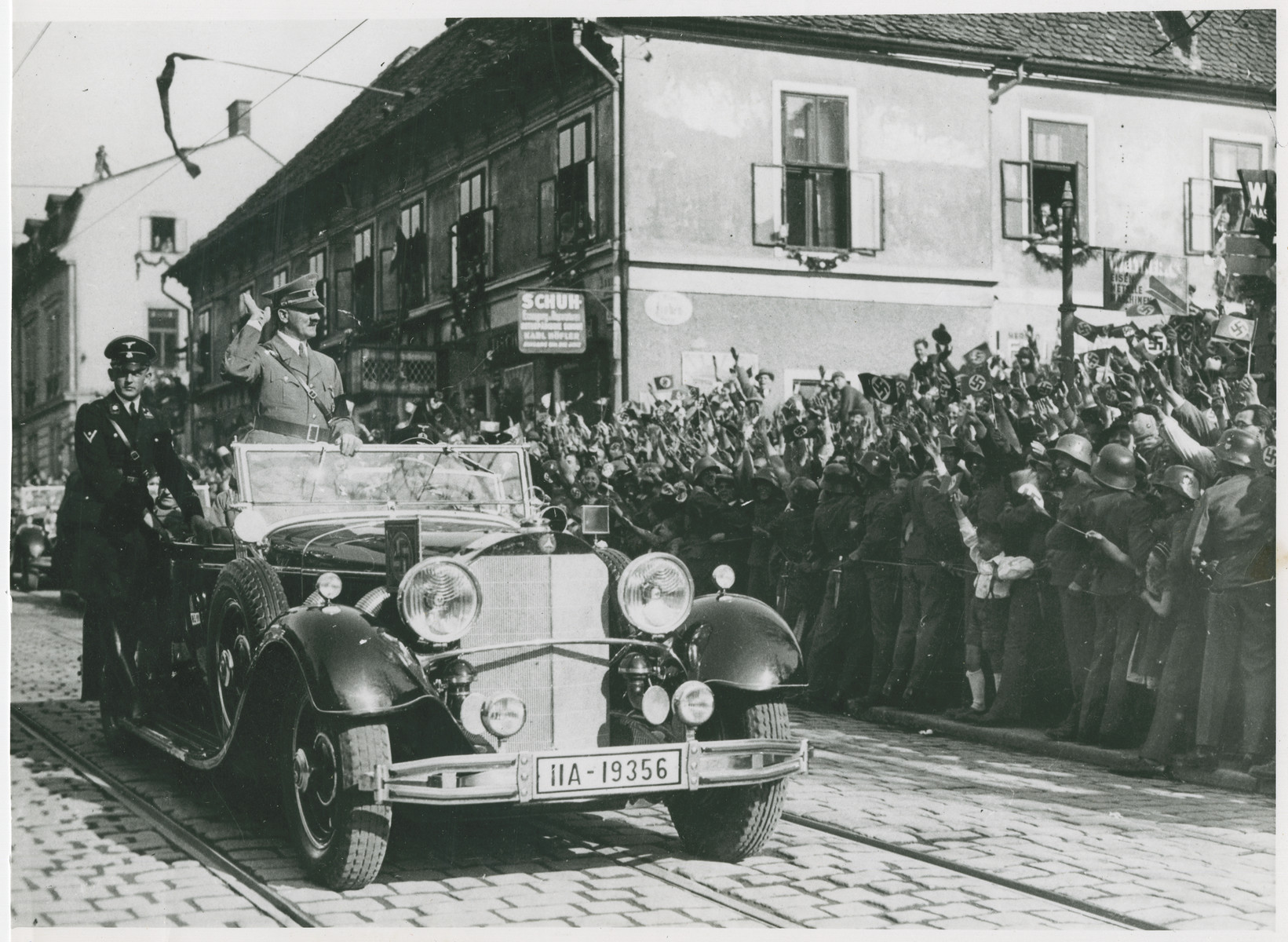 Hitler salutes welcoming crowd in Austria.