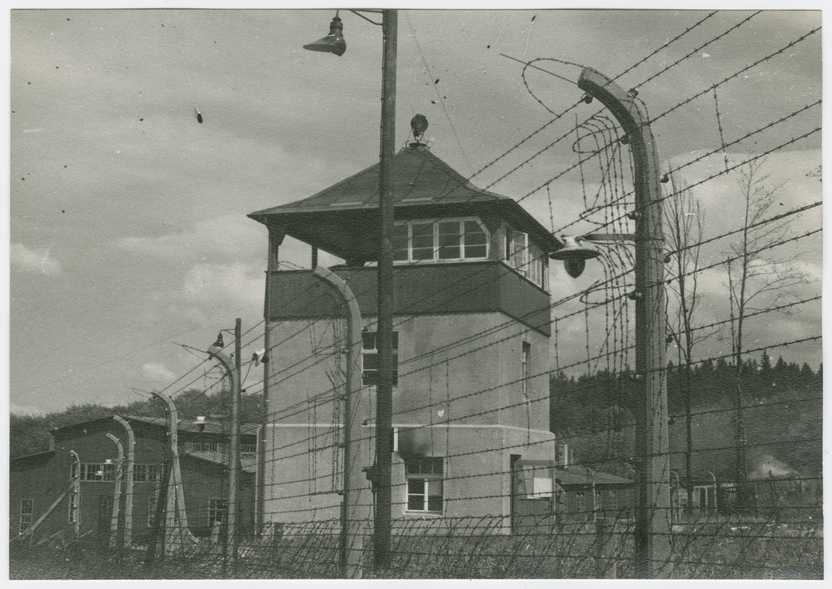 View of a watch tower and electrified fence in the Buchenwald concentration camp.