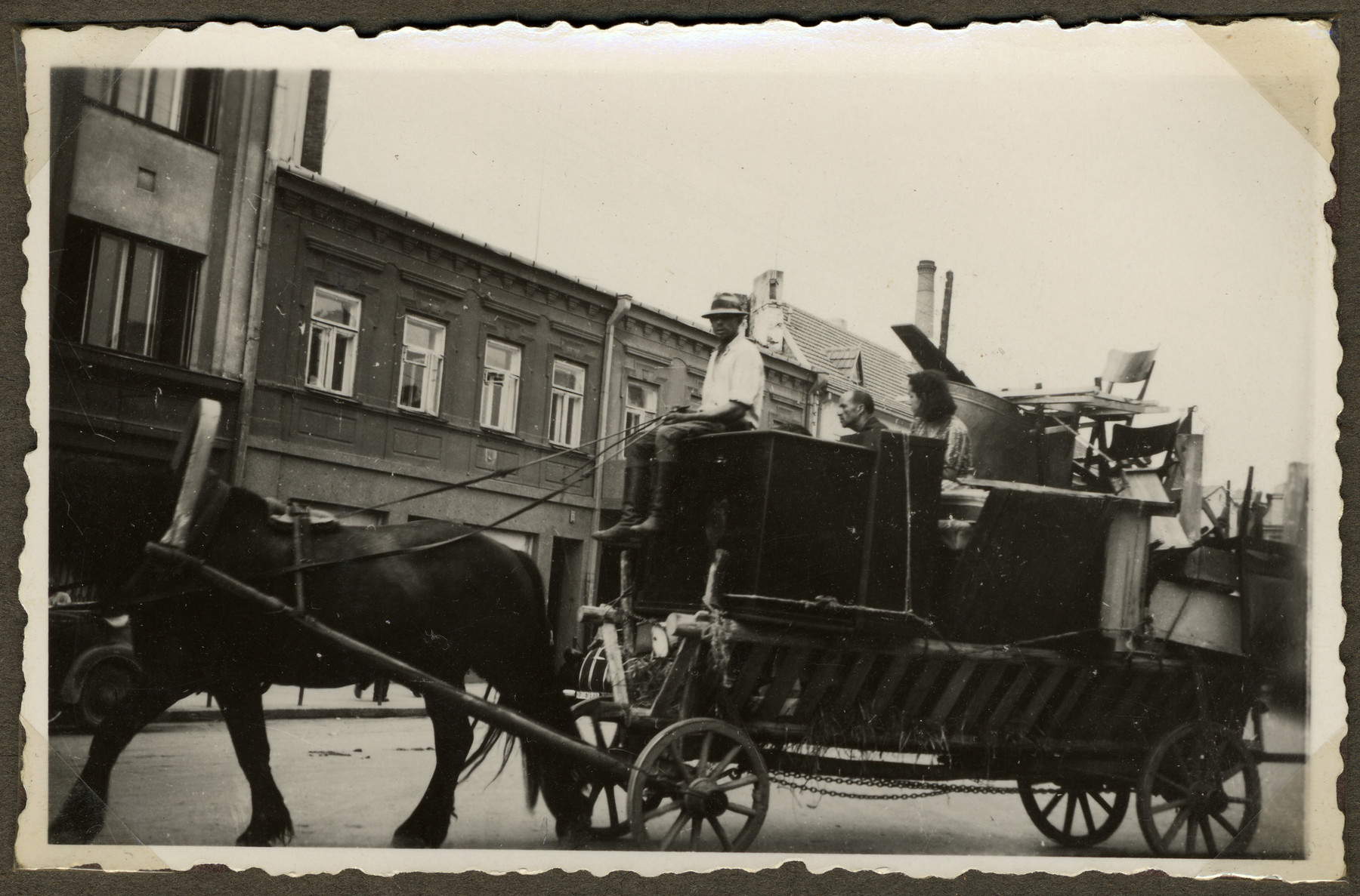 Jews move their belongings on carts and wagons from downtown Kaunas to the new ghetto located across the river in Slobodka.