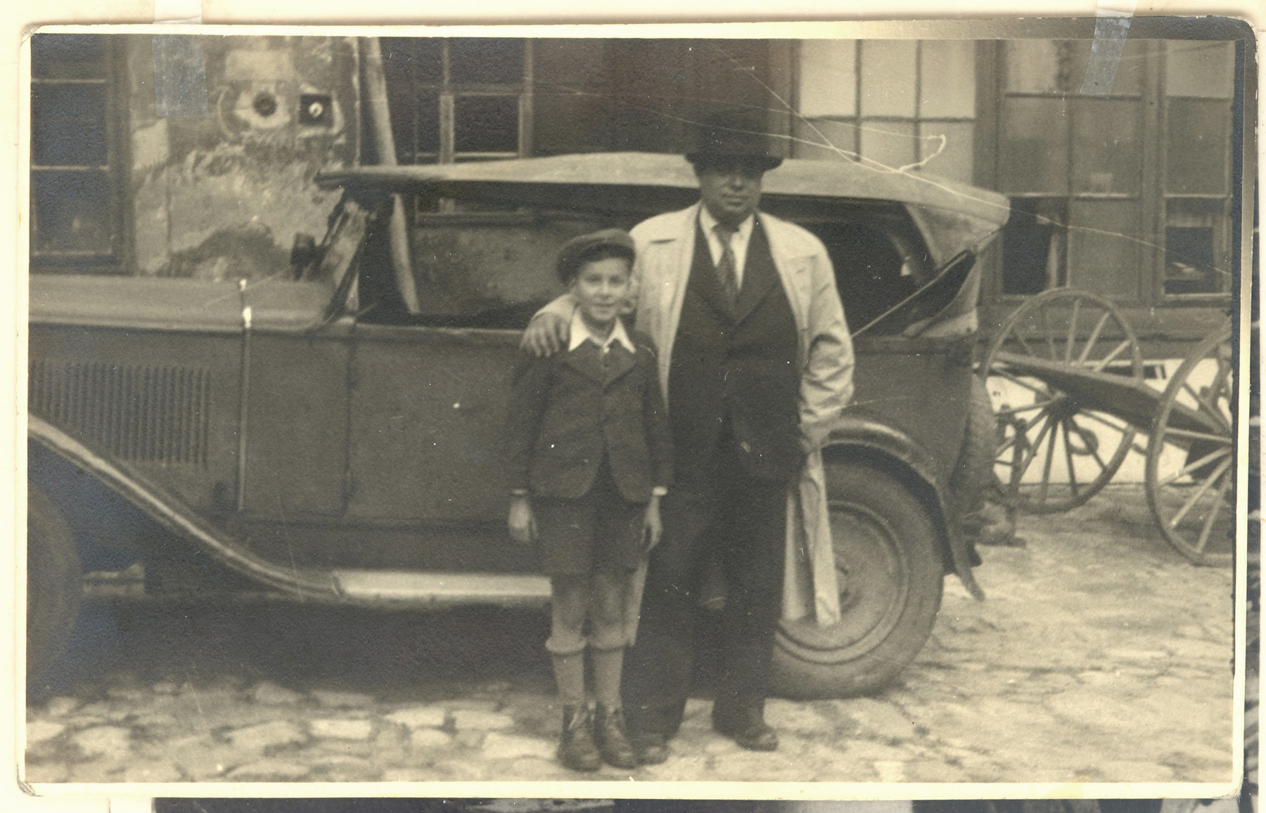 Jonas Eckstein poses with a Jewish orphan from Poland that he sheltered after he was smuggled over the border into Slovakia.