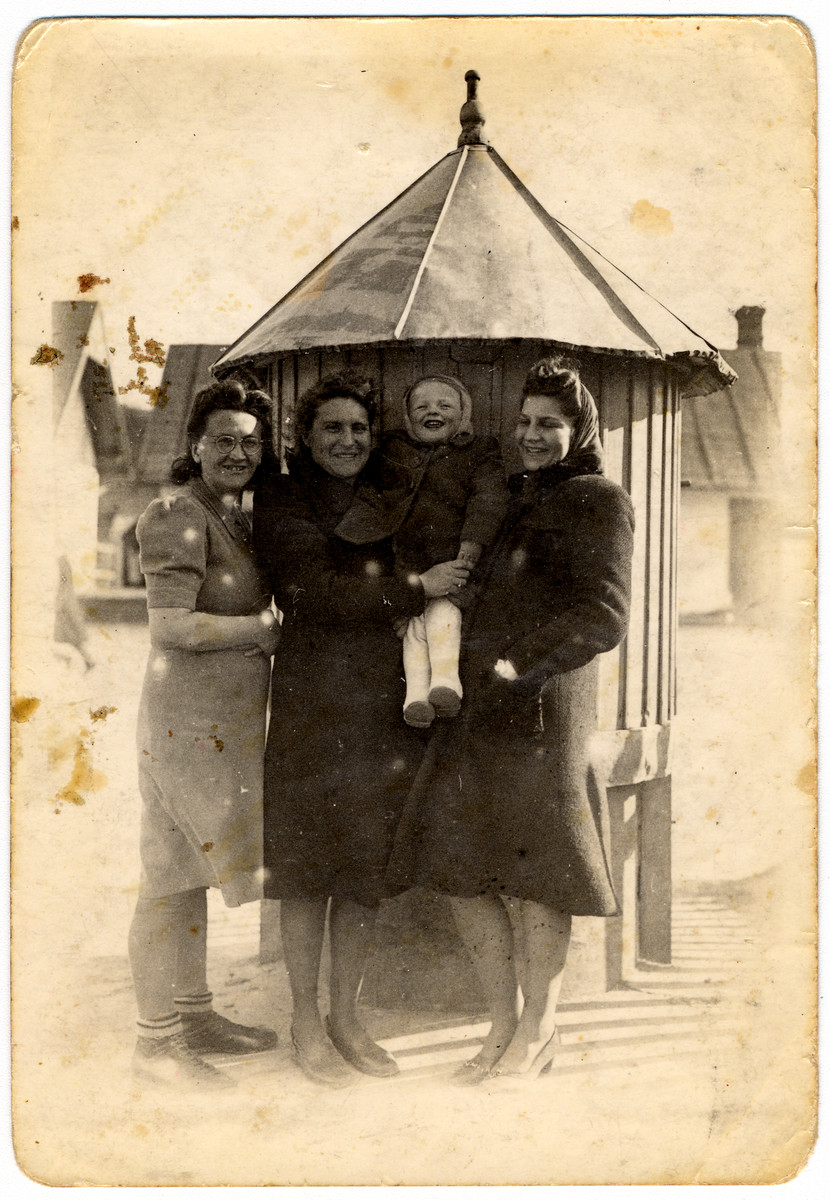 Two Jewish women in hiding pose with their Polish employer and her son.  From left to right are the employer Mrs. Ptashkowski, Blanka Bornstein, the employer's baby and Bronka Lerner.