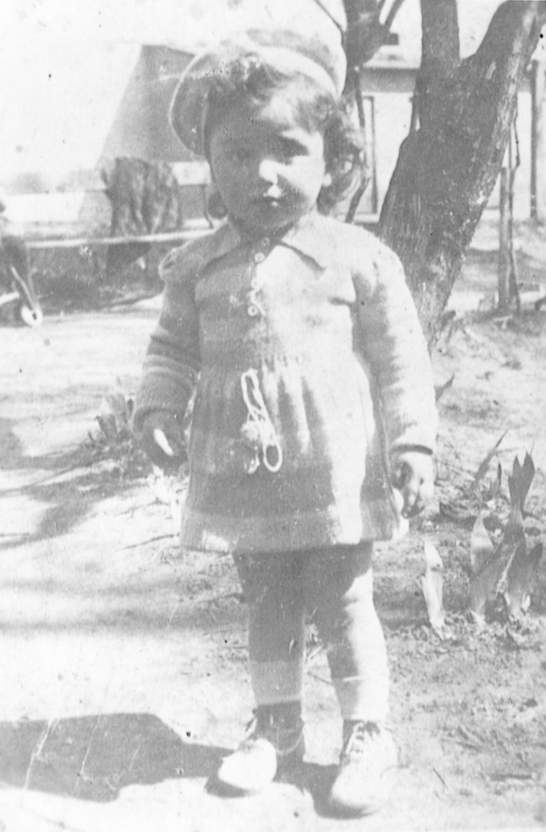 Close-up portrait of Chaja Magier, a young child in the Bedzin ghetto.
