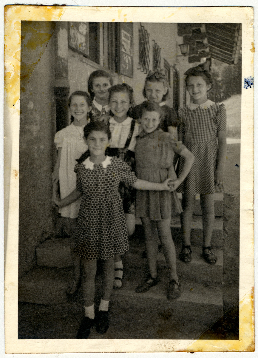 A group of school girls poses outside a building in the Feldafing displaced persons' camp.  Rifka Lifschitz is pictured in the third row, far left.  Ada Rosenberg is in the back center and Bela Danenhirsch is at the back, far right. Rutka Kron is in the middle.