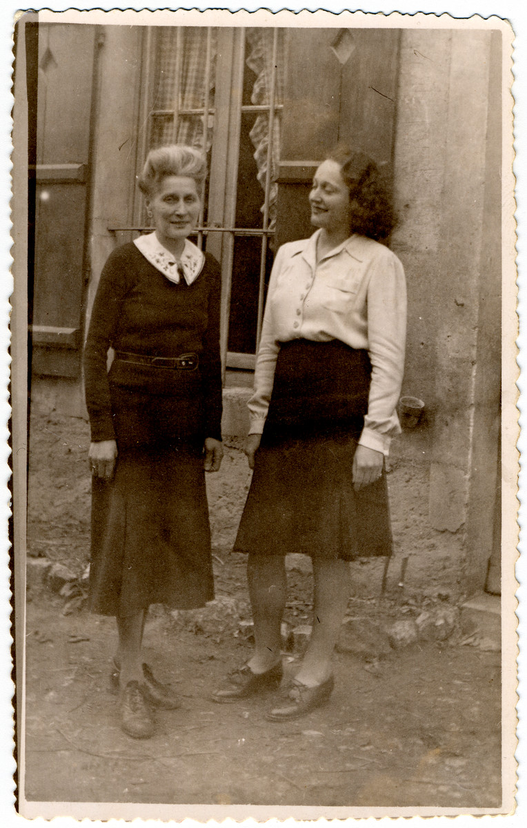 French rescuers, Marie-Therese Maunier and Genvieve Maunier-Valentine, stand outside their home.