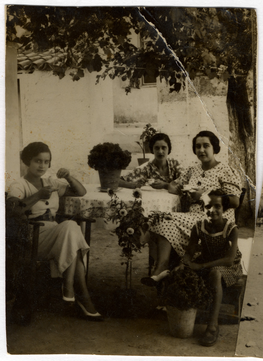 A group of young women seated around a table (Jesurun sisters?)