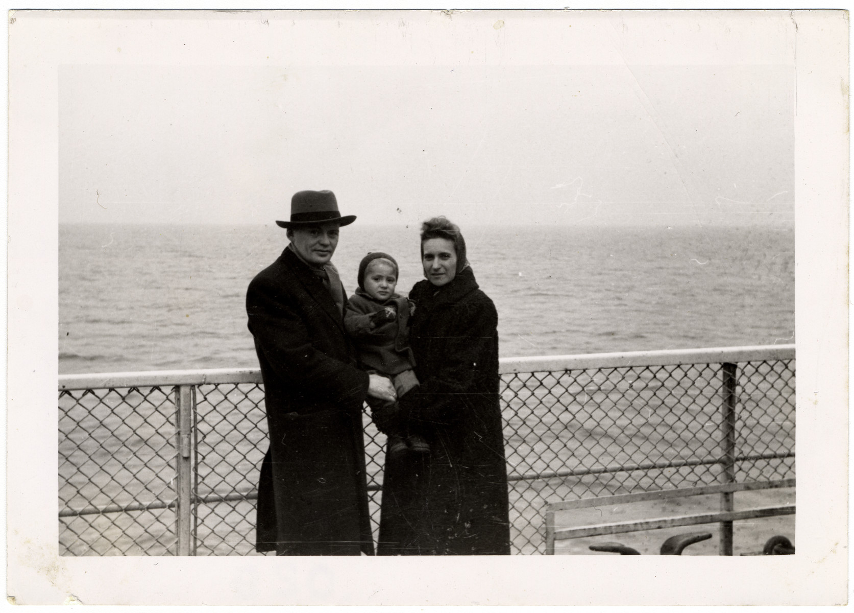 The Hochbaum family stands on the deck of the Marine Flasher while en route to the United States.  Pictured are Leon, Jeffrey and Blanche Hochbaum.