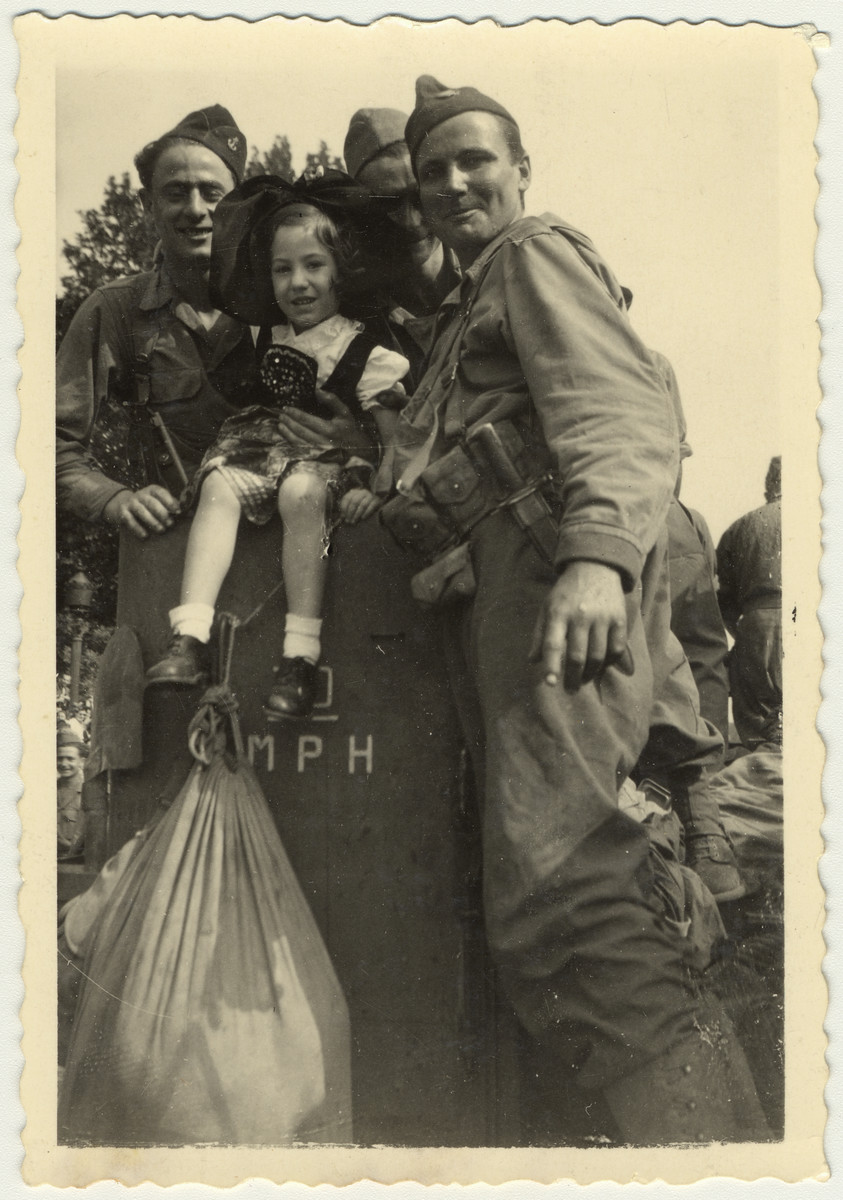 "Soldiers pose with a young girl during the liberation of France.   Original caption reads: ""Paris, Sept. 1944, The Liberation."""