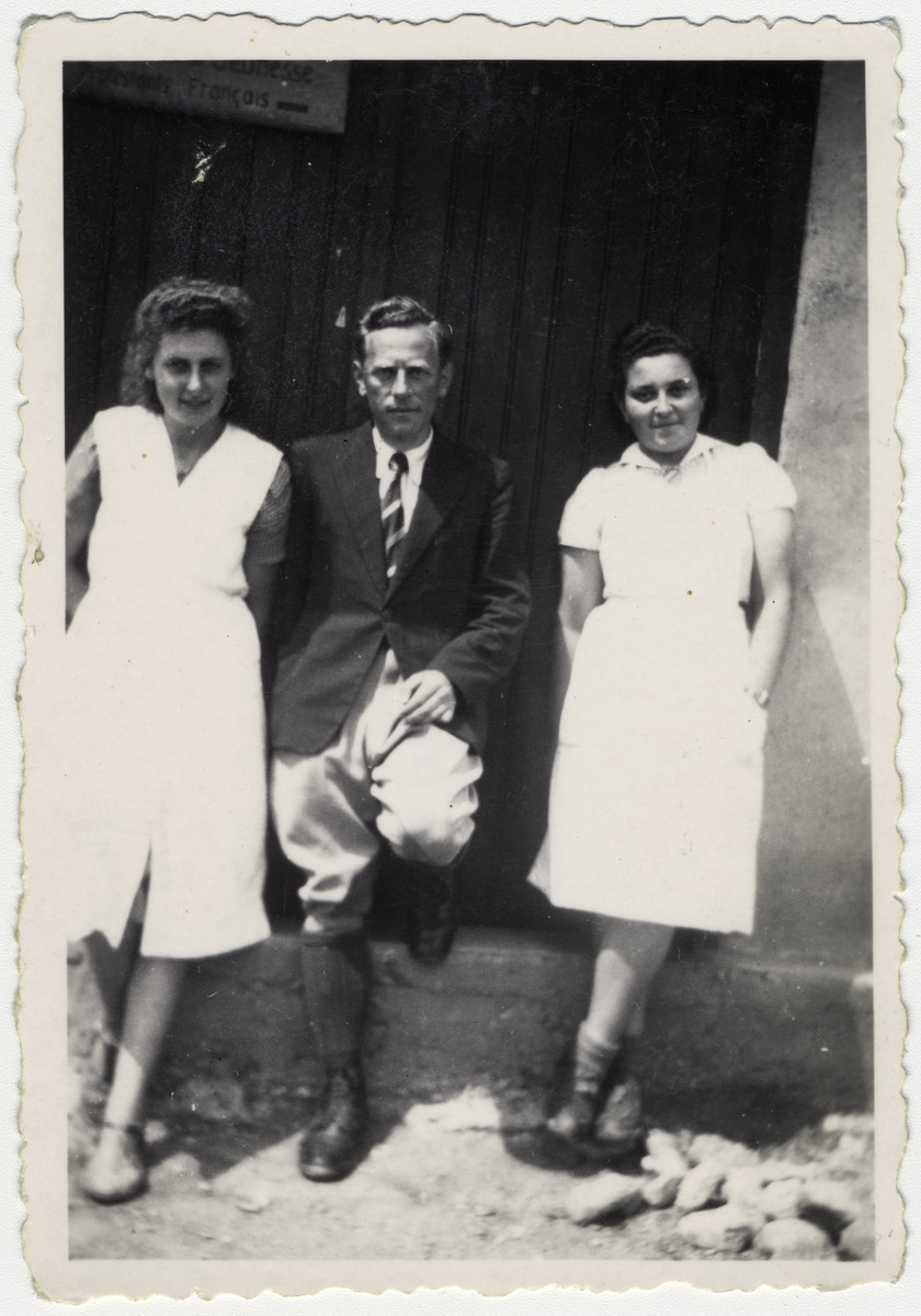 """Dr. Malkin poses with his aides outside the infirmary at the Rivesaltes internment camp.   Original caption reads: """"Dr. Malkin with his camp assistants. OSE."""""""