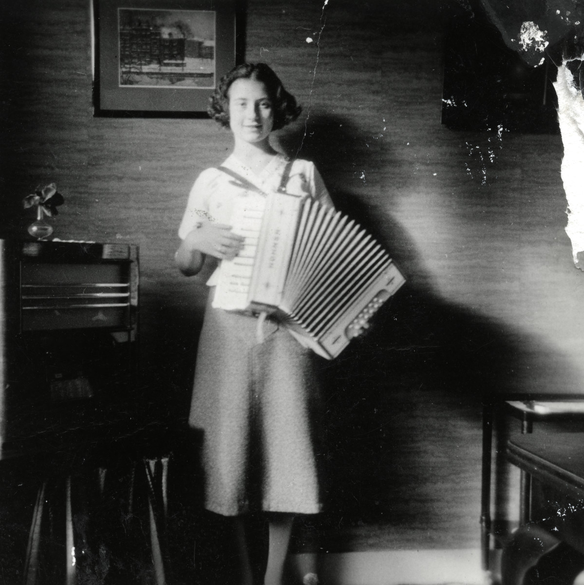 Ellis Cohen-Paraira plays the accordian in her home.