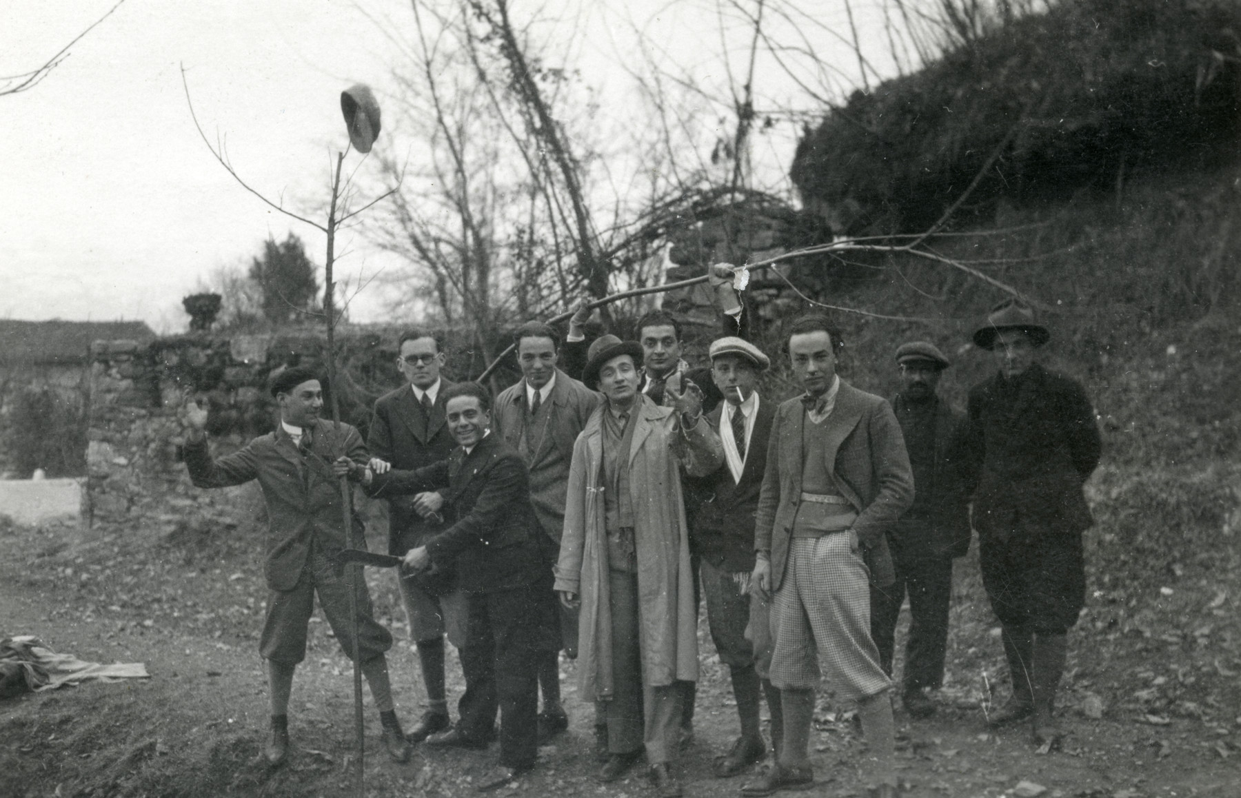 Group portrait of university students on an outing.  Salomon Finci, the donor's father, stands in the back holding up a tree branch during his time as a chemical engineeringstudent.