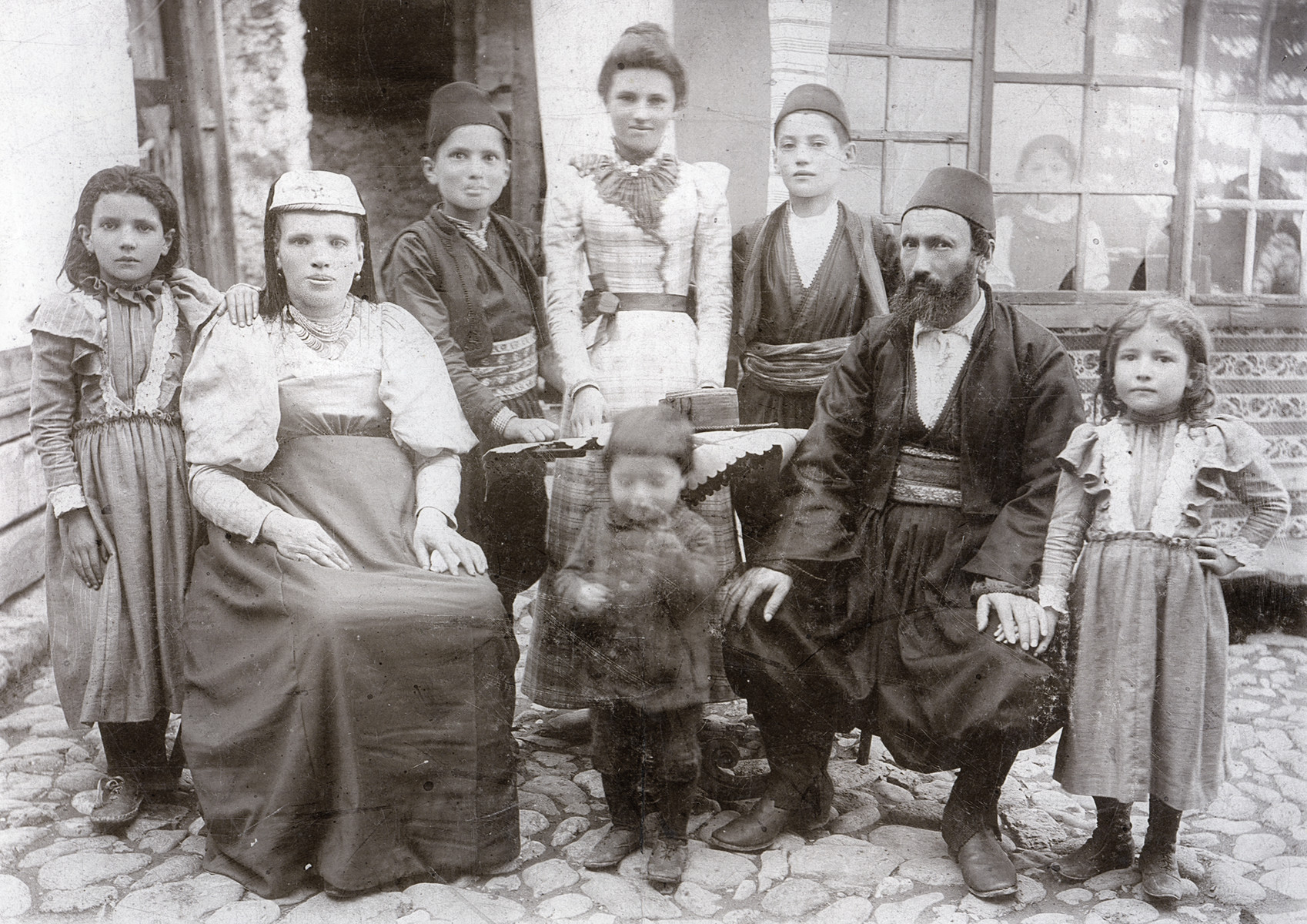 Prewar family portrait of the Kajon (Hajon) family.  Pictured are Sarah and Mordechai Kajon  (the great grandparents of donor)  with their children (from left to right): Simcha, Joseph, Esther, Izak, Leah (Lenka), and Elias (in the center).