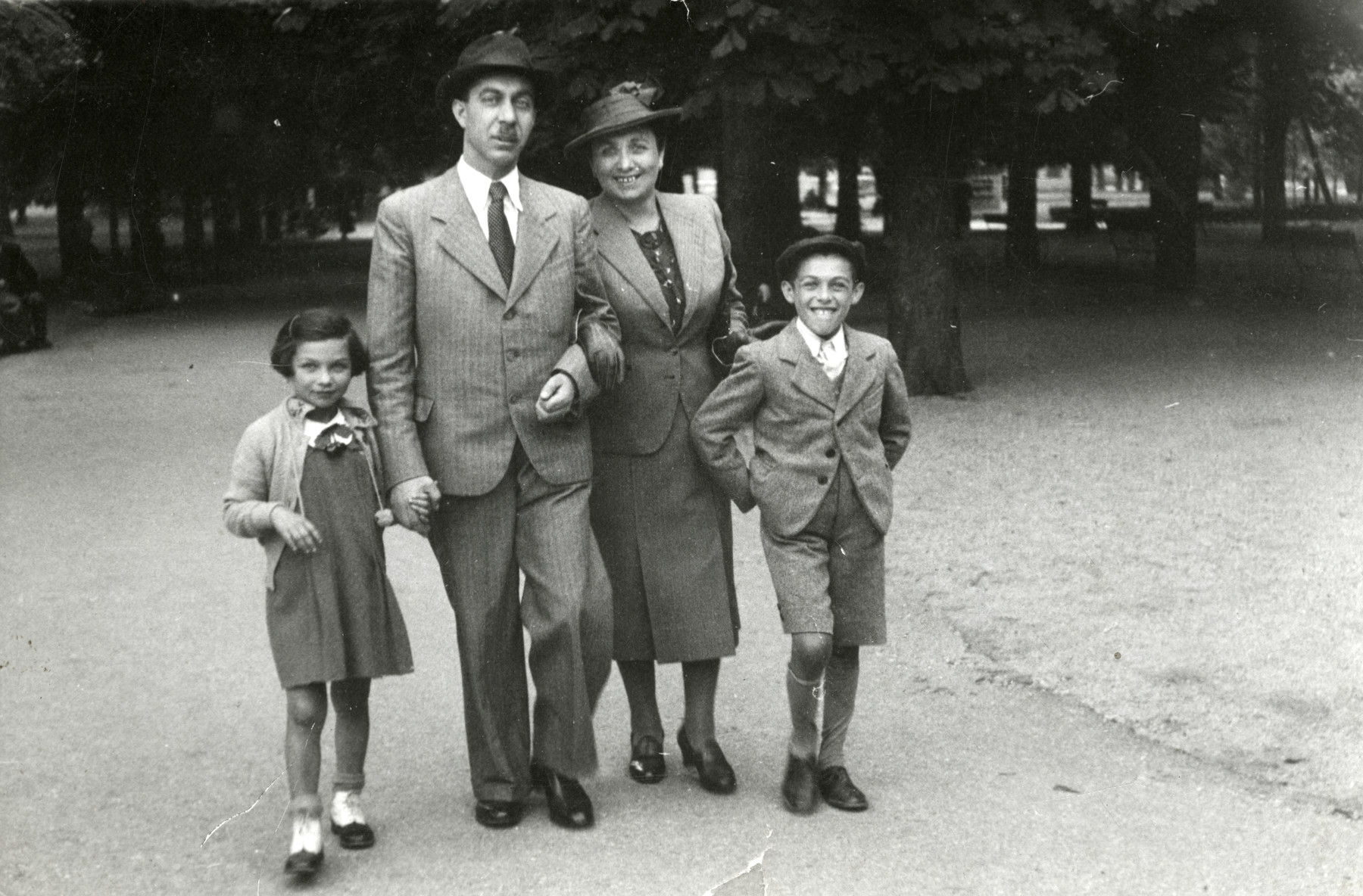 The Eckstein family poses together in a park in prewar Bratislava.  Pictured left to right are Eva, Eugene (Jeno), Helena and Ernst (Benjamin) Eckstein.