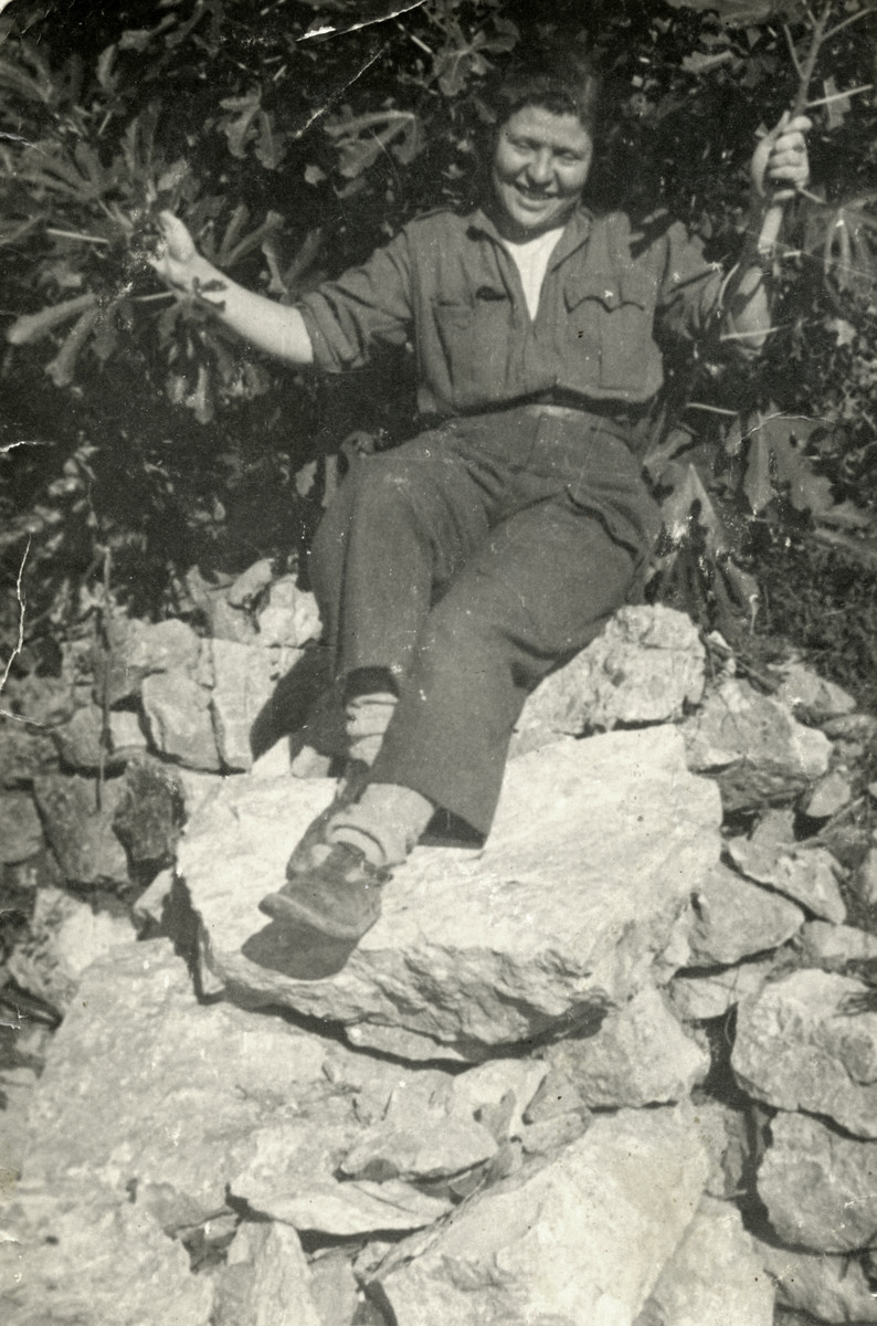Tina Hajon sits on some large rocks while serving as a partisan.