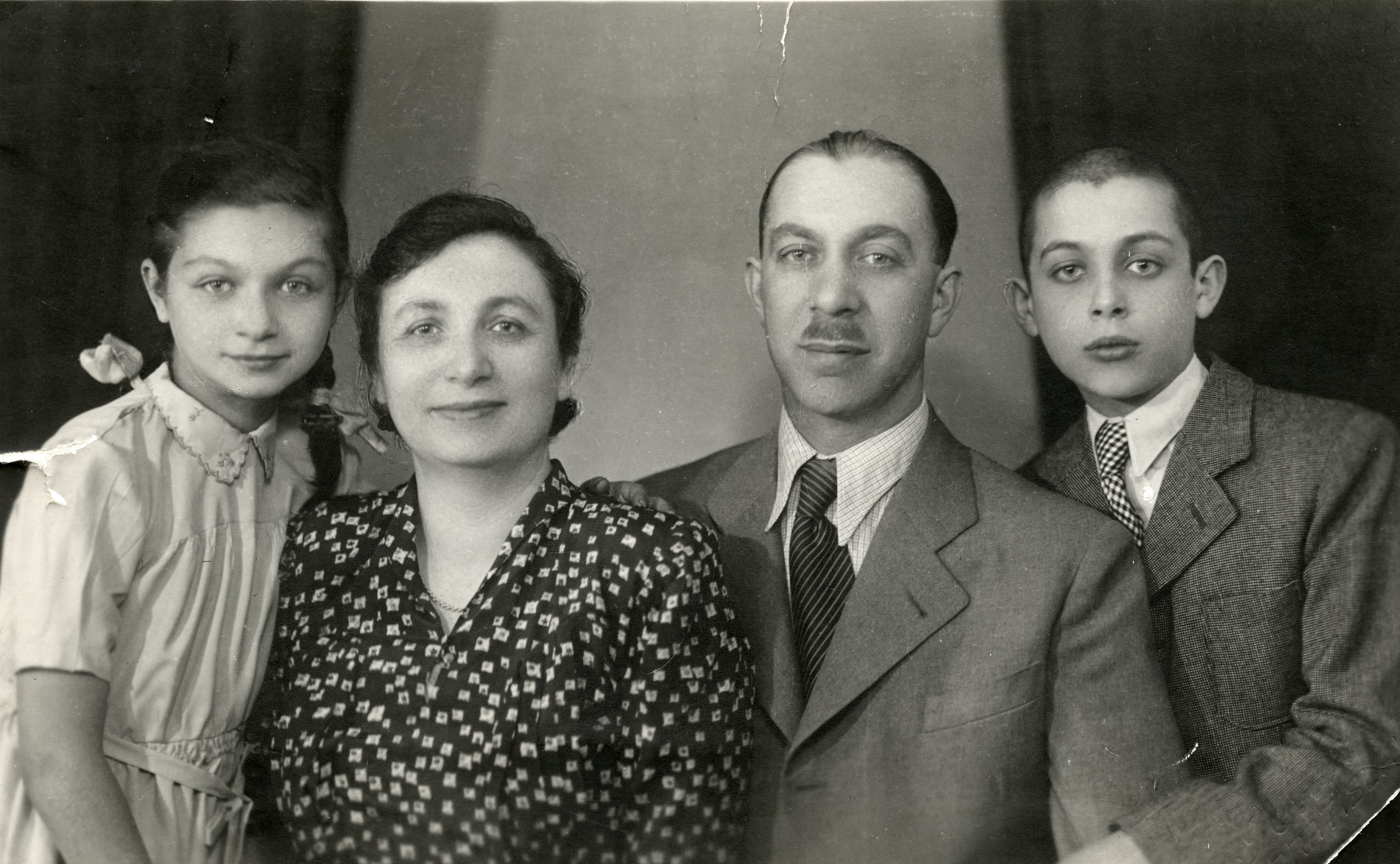 Studio portrait of the Eckstein family in wartime Bratislava.  Pictured from left to right are Eva, Helena, Eugene and Ernst (Benjamin) Eckstein.