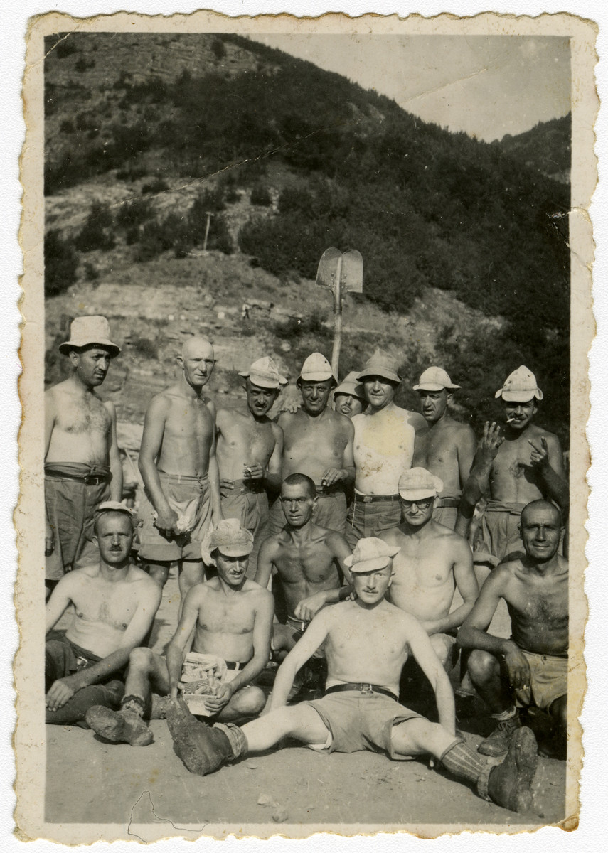 Group portrait of Bulgarian Jews in a forced labor brigade in Bov.  Isaac Varsano is standing in the center.