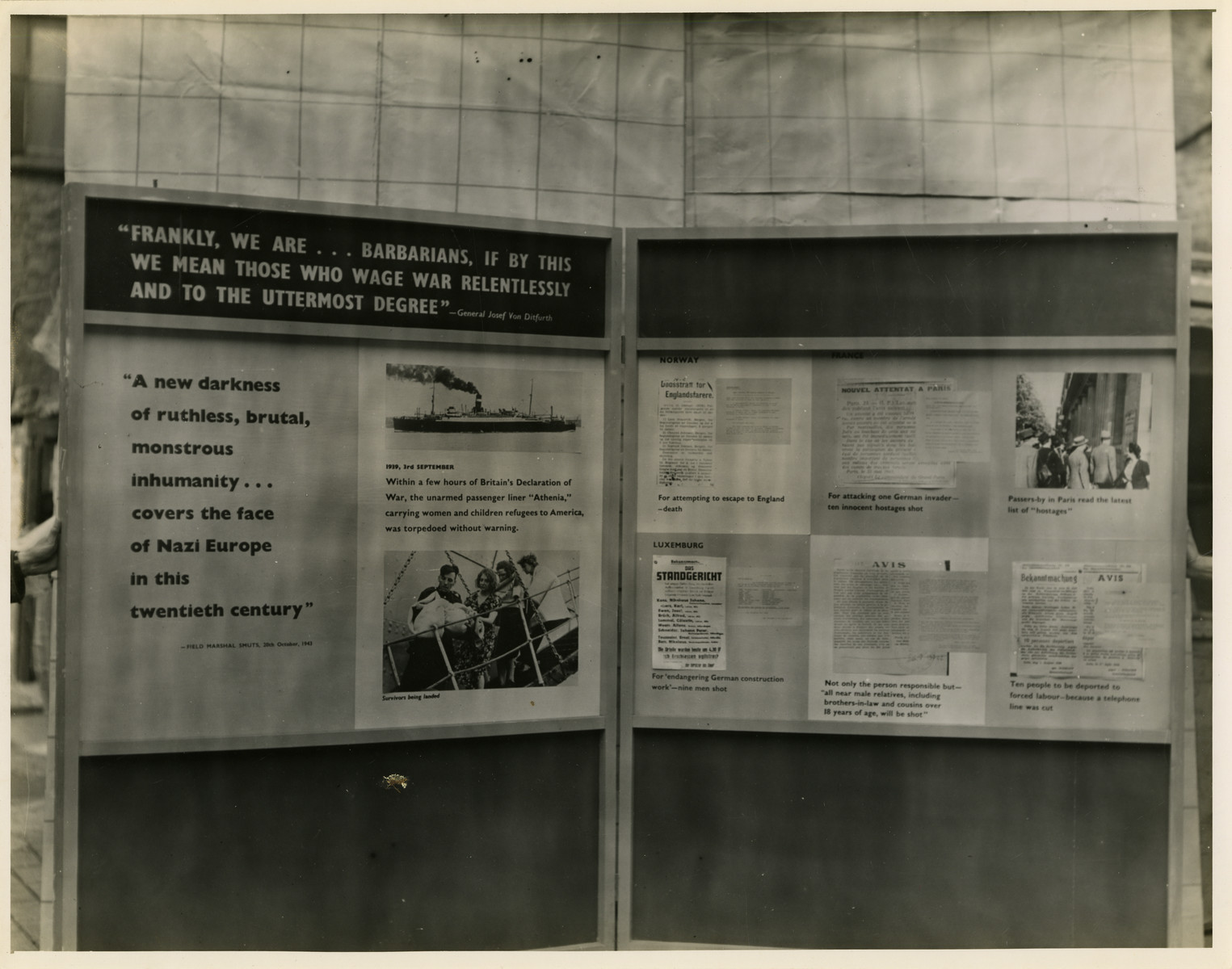 "Panel from a 1944 exhibition in London, England, entitled ""Germany- the Evidence"" showing various Nazi acts of violence.   The panel reads ""' Frankly, we are... barbarians, if by this we mean those who wage war relentlessly and to the uttermost degree' General Josef von Ditfurth.""  Beneath is another quotation ""' A new darkness of ruthless, brutal, monstrous inhumanity... covers the face of Nazi Europe in this twentieth century. ' Field Marshall Smuts 20th, October 1943.""   The back of the photo reads ""British Official Photograph; Distrbuted by the Ministry of Information. D. ; The Evil We Fight.; Ministry of Information Exhibition priduced by Display & Exhibitions Division for show all over Great Britain.; Display panel"""