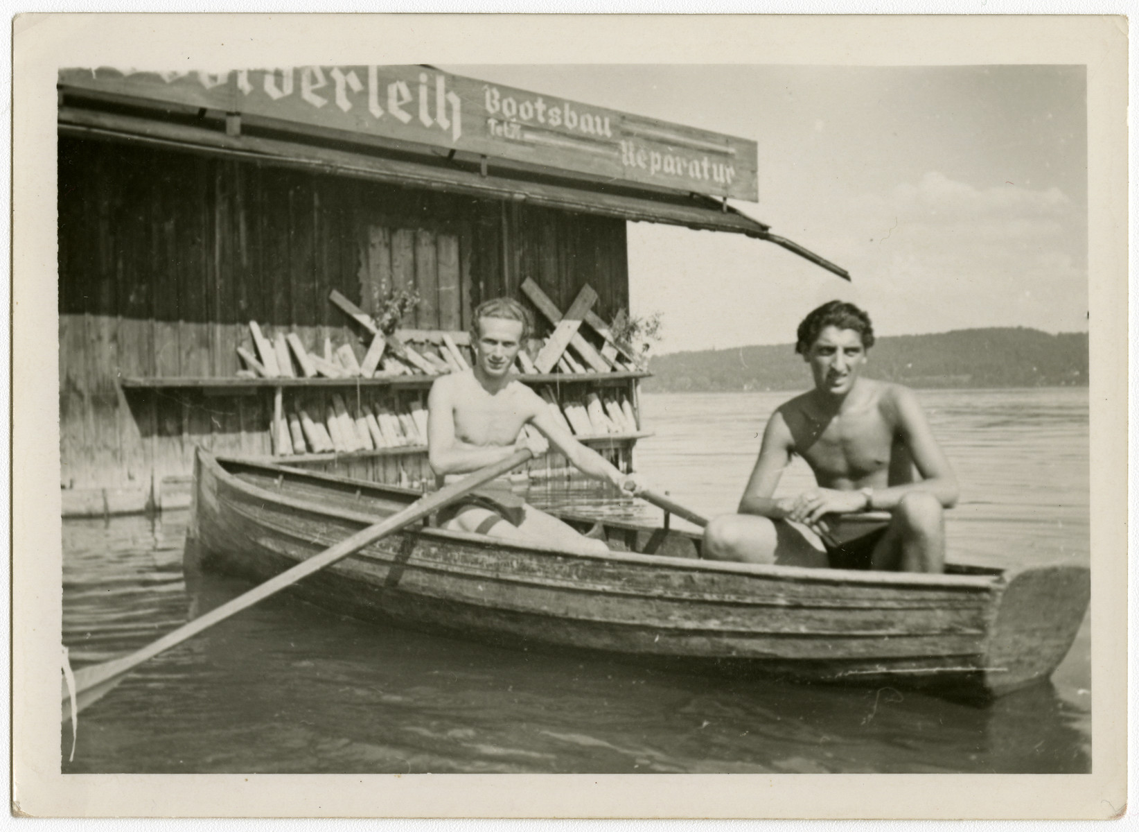 Two young men go boating on the Starnberger Sea near the Feldafing displaced persons camp.  Henek Haberman is on the left and Chamek (Harry) Weinroth is on the right.