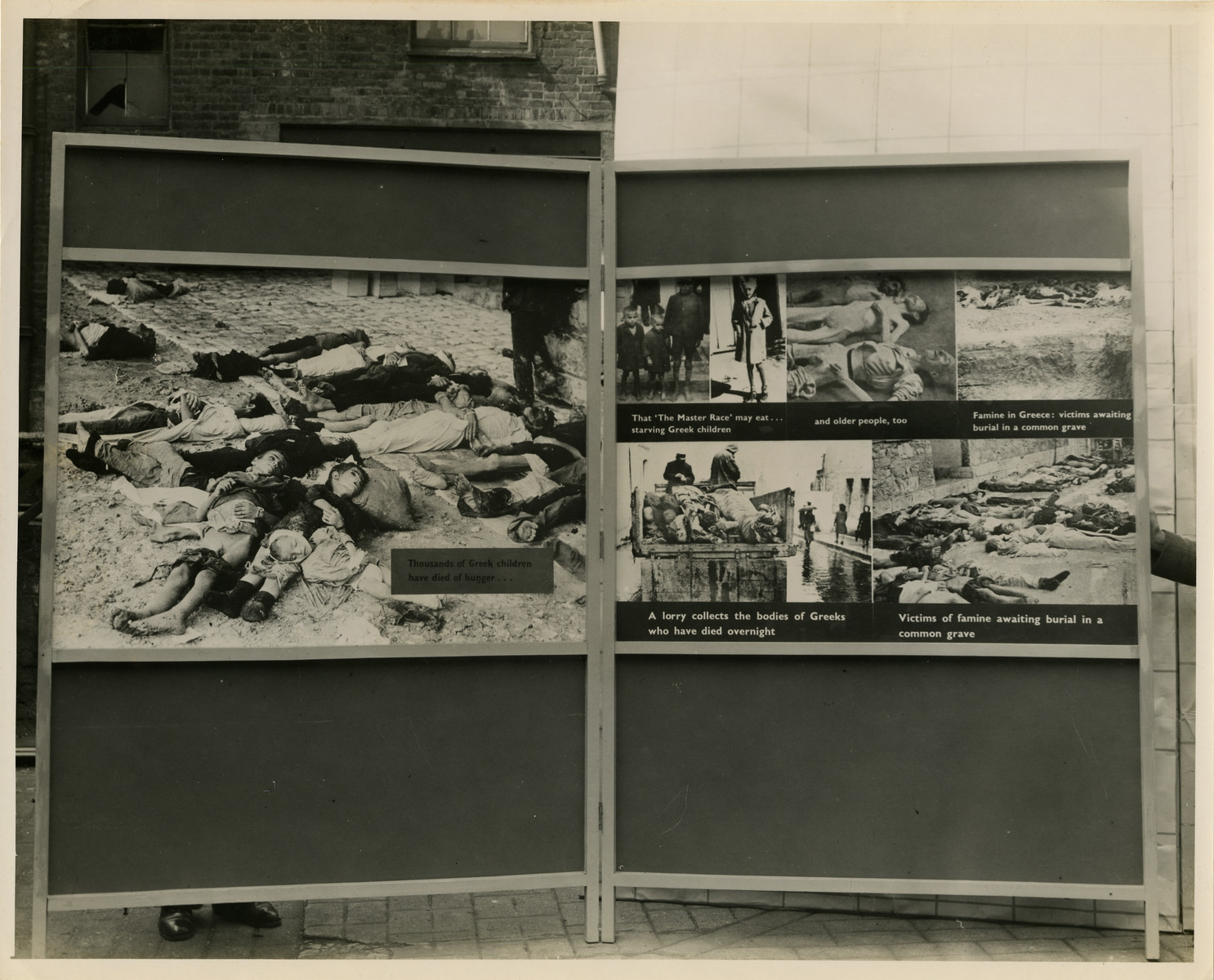 "Panel from a 1944 exhibition in London, England, entitled ""Germany- the Evidence"" showing Greek victims of the Nazi Regime.   The panel shows pictures of emaciated Greek victims, both young and old, who died due to famine.   The back of the photo reads ""British Official Photograph; Distrbuted by the Ministry of Information. D. ; The Evil We Fight.; Ministry of Information Exhibition priduced by Display &Exhibitions Division for show all over Great Britain.; Display panel"""