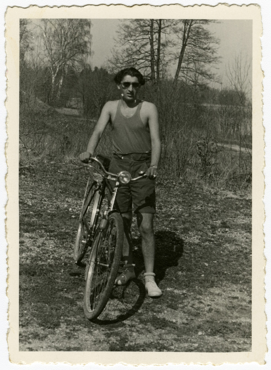 Chamek (Harry) Weinroth rides his bicycle in the Feldafing displaced persons camp.