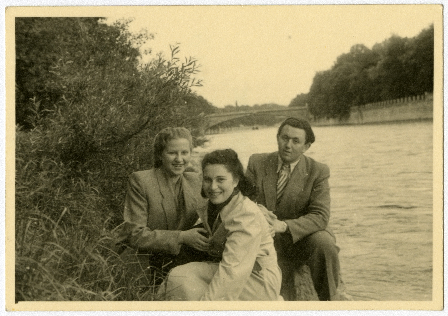 Three friends sit on the bank of the Starnberger Sea in the Feldafing displaced persons camp.  Pictured are Luba Kerschenblat, Frieda Wilner and Yeshayahu Zycer.