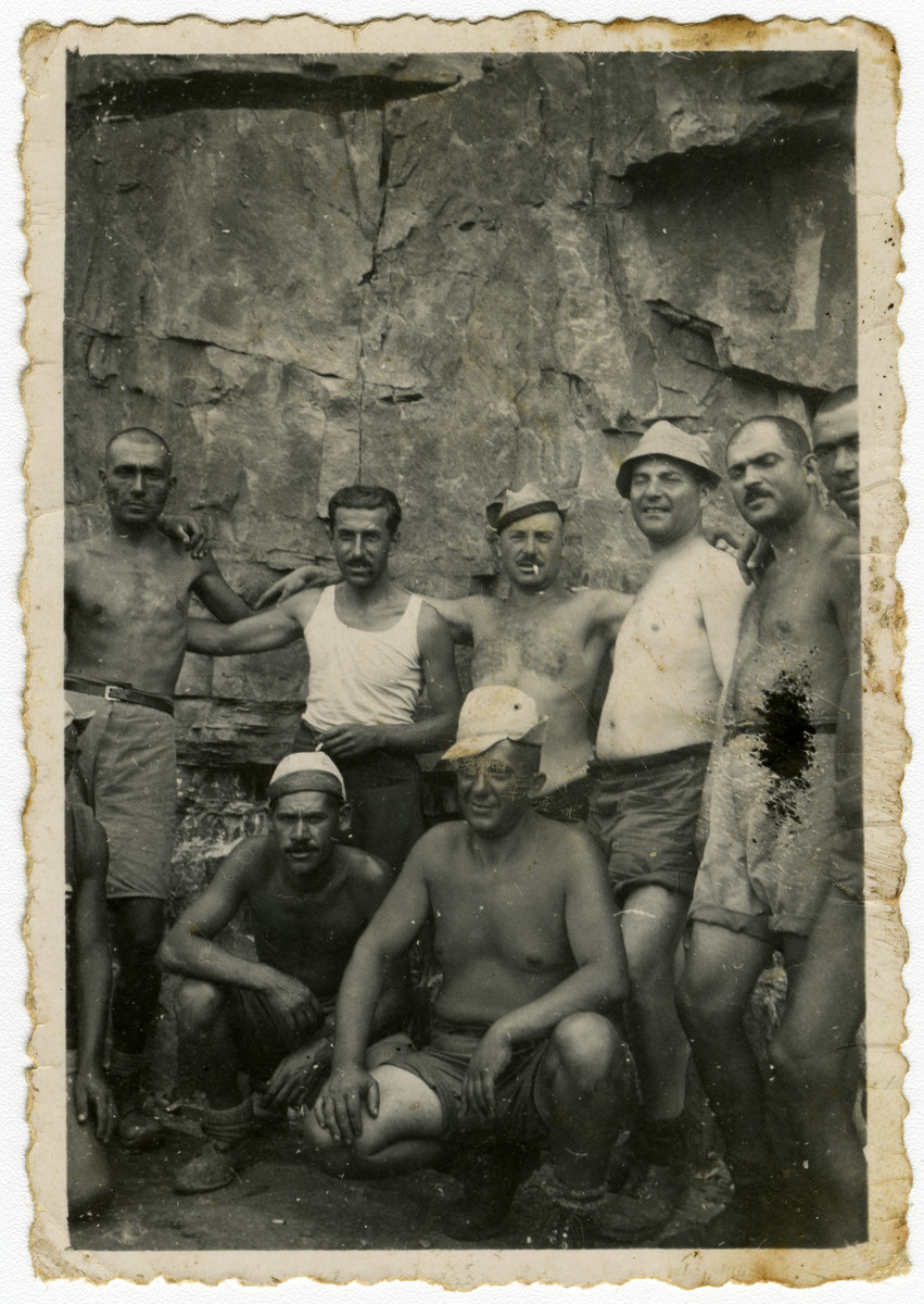 Group portrait of Bulgarian Jews in a forced labor brigade in Bov.  Isaac Varsano is sqautting on the right.