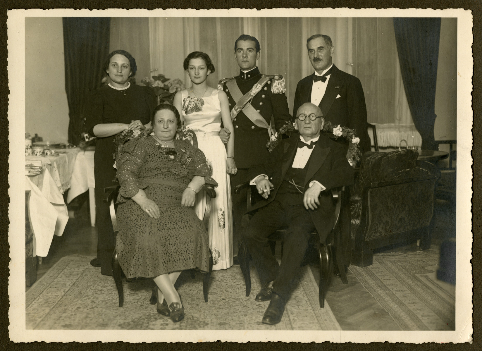Wedding portrait of Helga Reinsch and Mario Pelligrino.  Seated are Olga and Isaak Abraham.  Standing are Hannie Reinsch,Helga Reinsch, Mario Pelligrino, and Karl Reinsch.