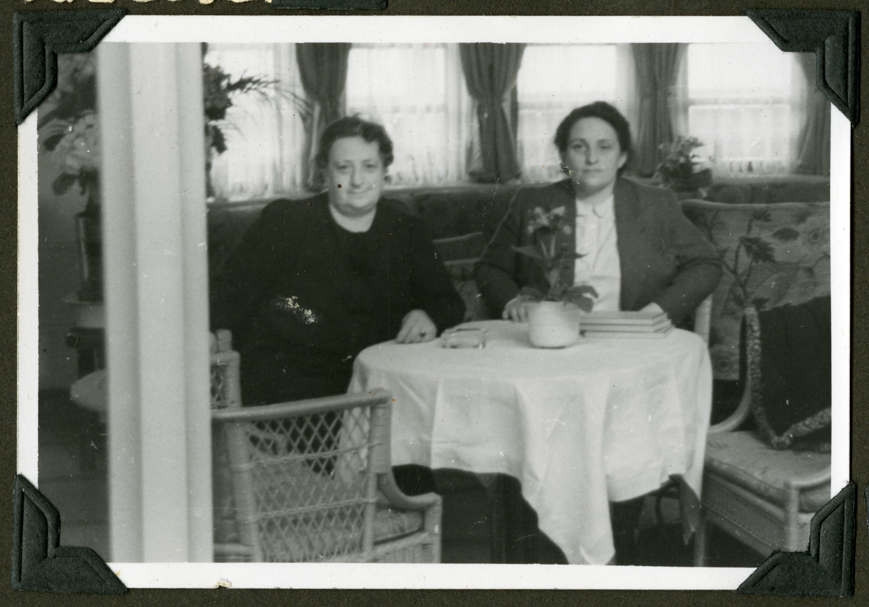 Olga Abraham and Hannie Reinsch sit at a table in either Cuba or the States after emigrating from Germany.