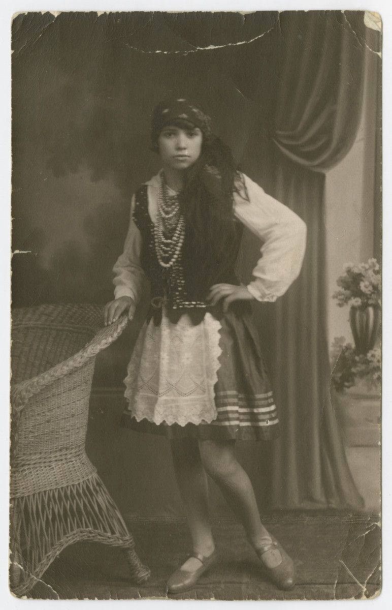 Studio portrait of Baila Lubochinski, the sister of Malka Lubochinski, dressed in a folk costume.