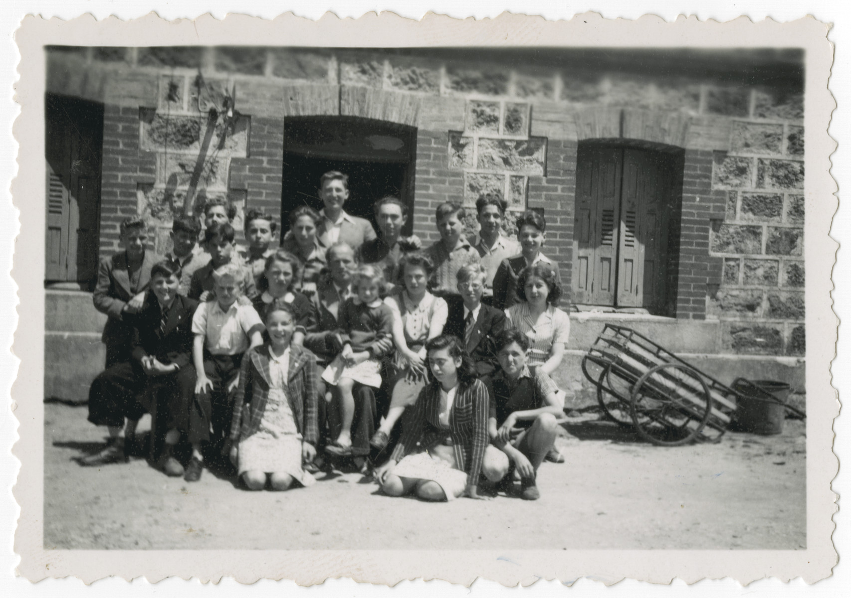 "Group portrait of children staying at the Les Grillons home in Le Chambon-sur-Lignon.  The original caption reads"" All the family of Les Grillons one Sunday."""