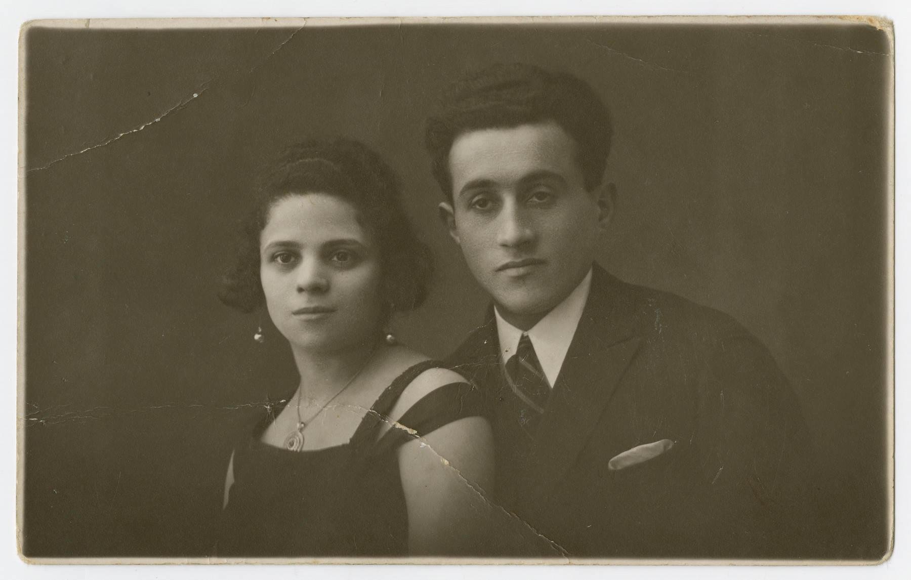 Studio portrait of Chaya Rasha Lubochinski Zelkowicz and her husband Issak Zelkowicz.  They survived the war in hiding in a church and after the war had three children Henri, Esther and Evelyne, .