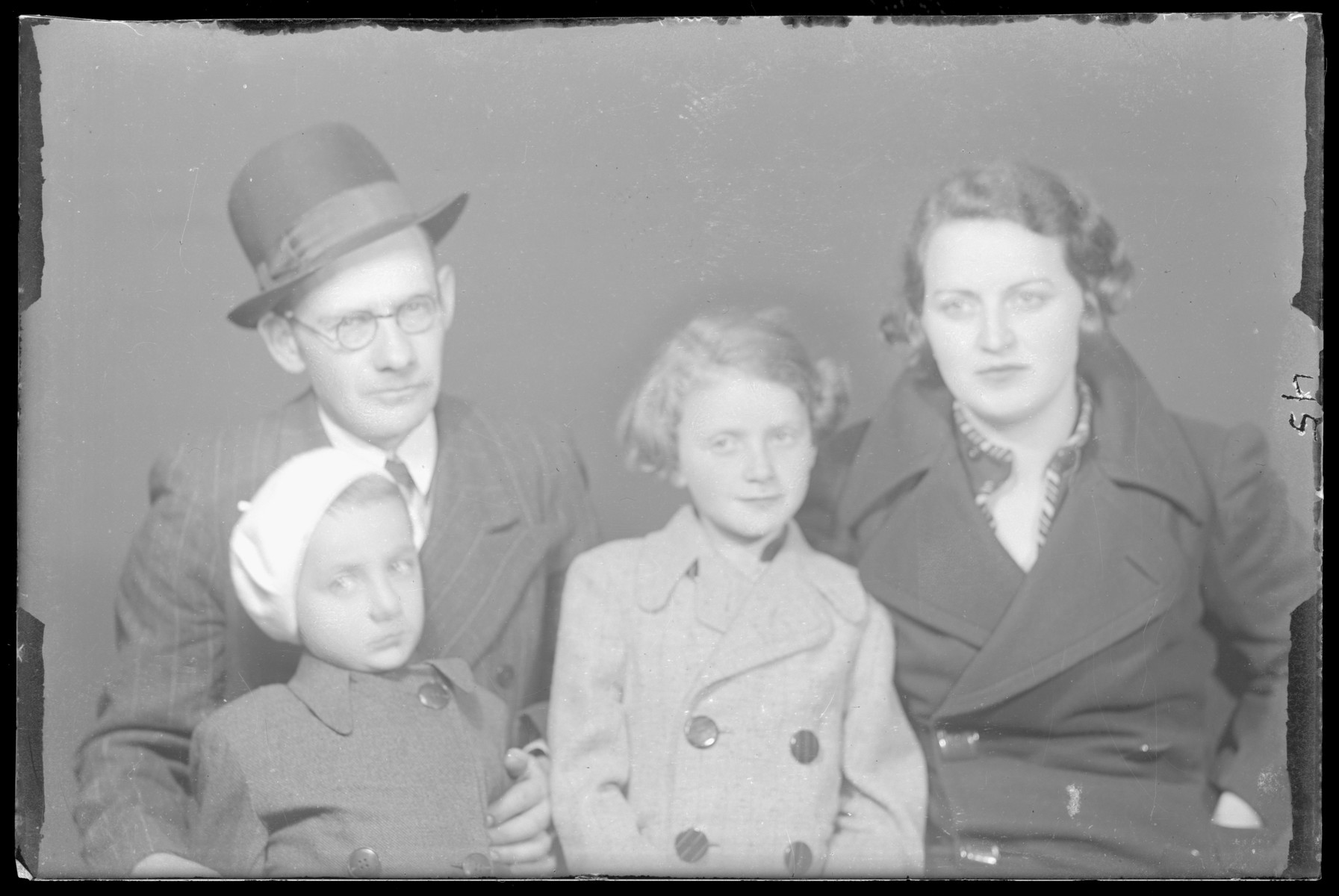 Studio portrait of Csalad Goldstein and family.